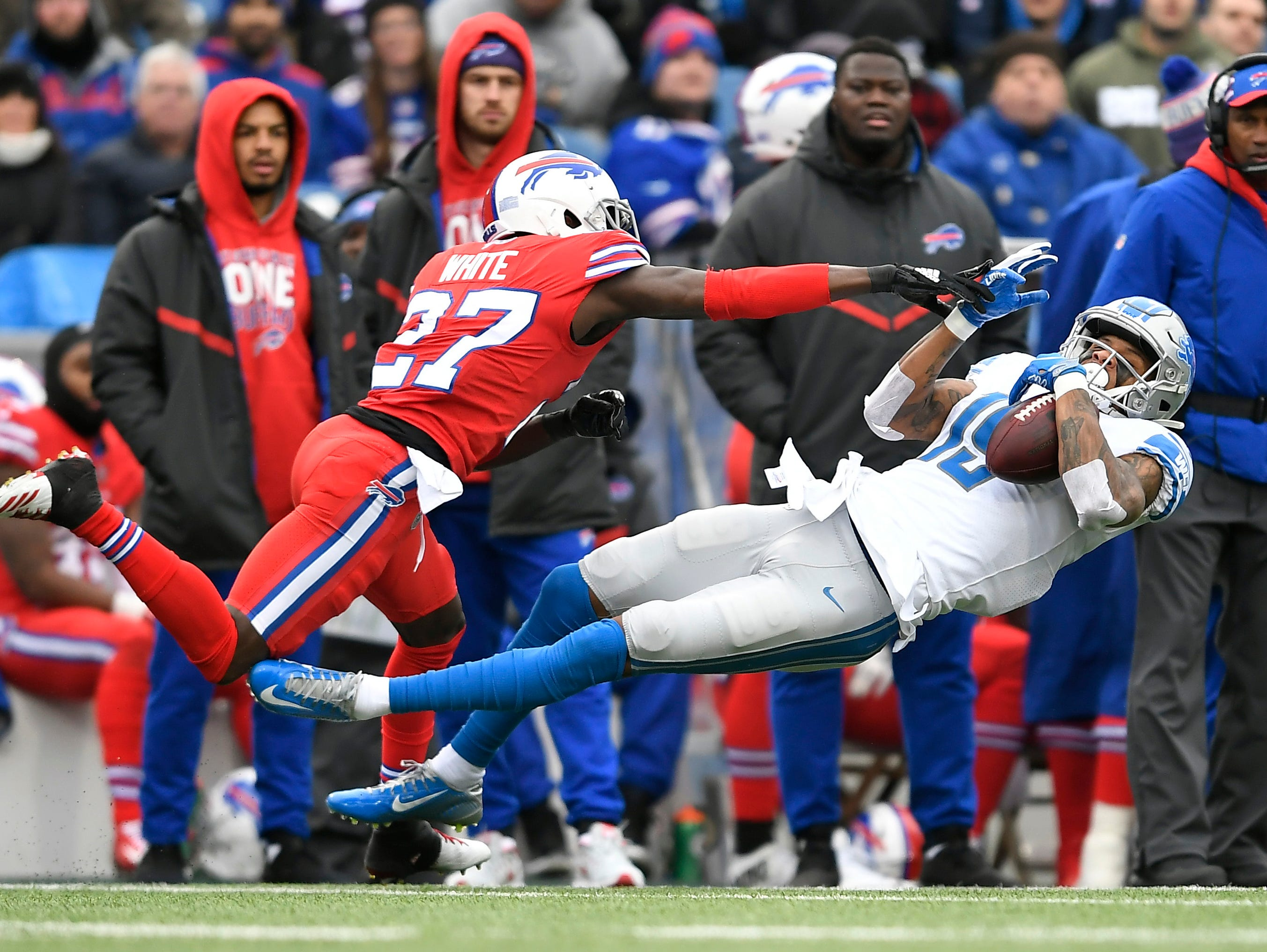 Detroit Lions wide receiver Kenny Golladay (19) catches a pass against Buffalo Bills cornerback Tre'Davious White (27) during the first half.