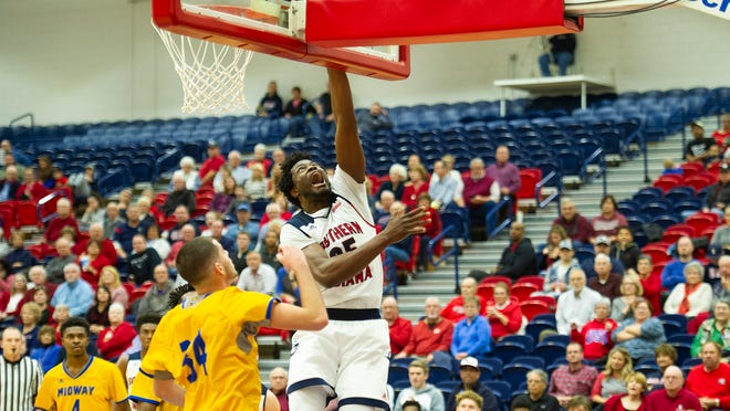 USI forward Hugo Mbumba puts up a shot in the second half of the Eagles' 96-63 win over Midway on Sunday, Dec. 16.