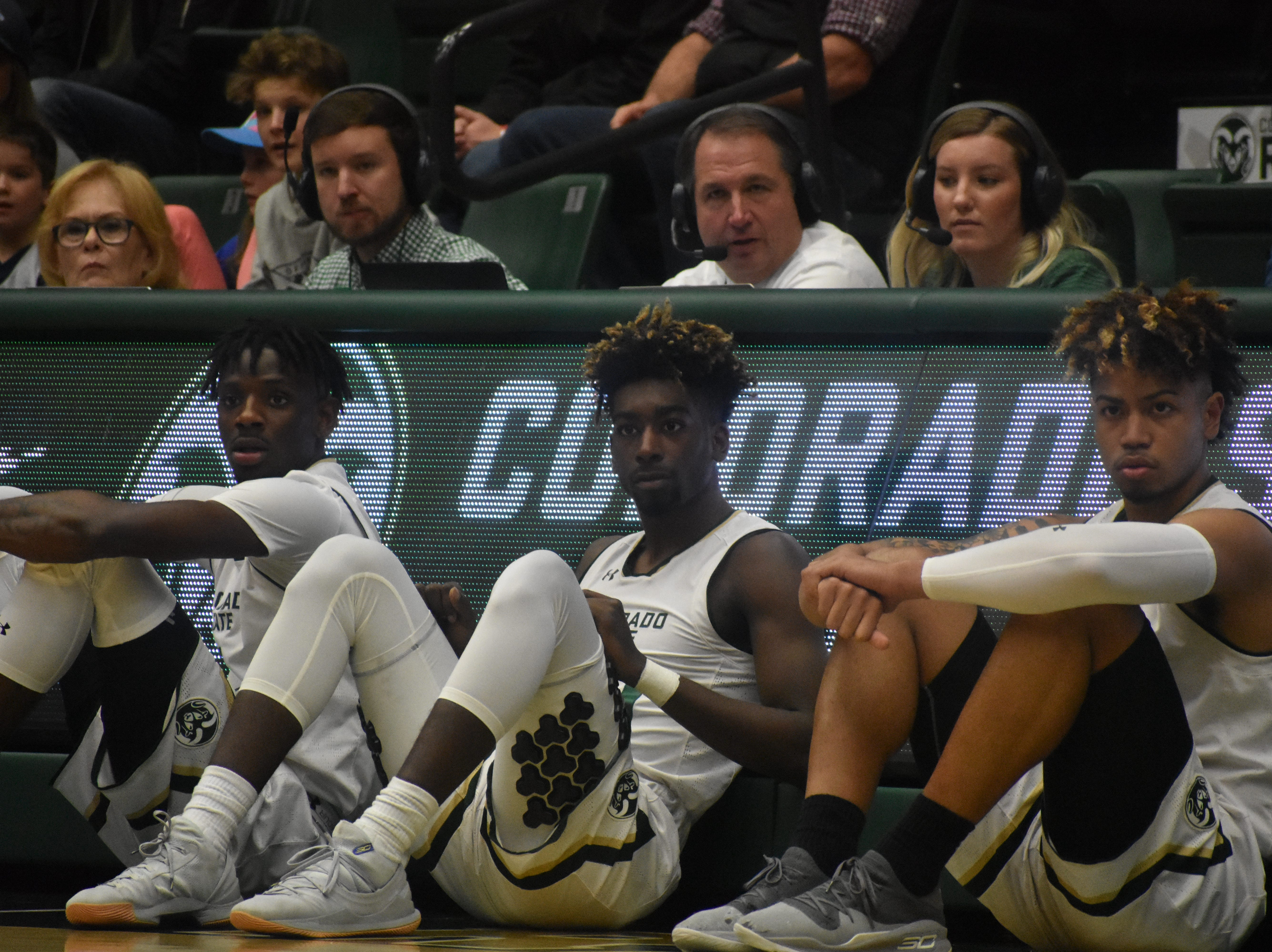 From left, CSU basketball players Zo Tyson, Kris Martin and Lorenzo Jenkins wait to sub into Sunday's game against South Dakota.