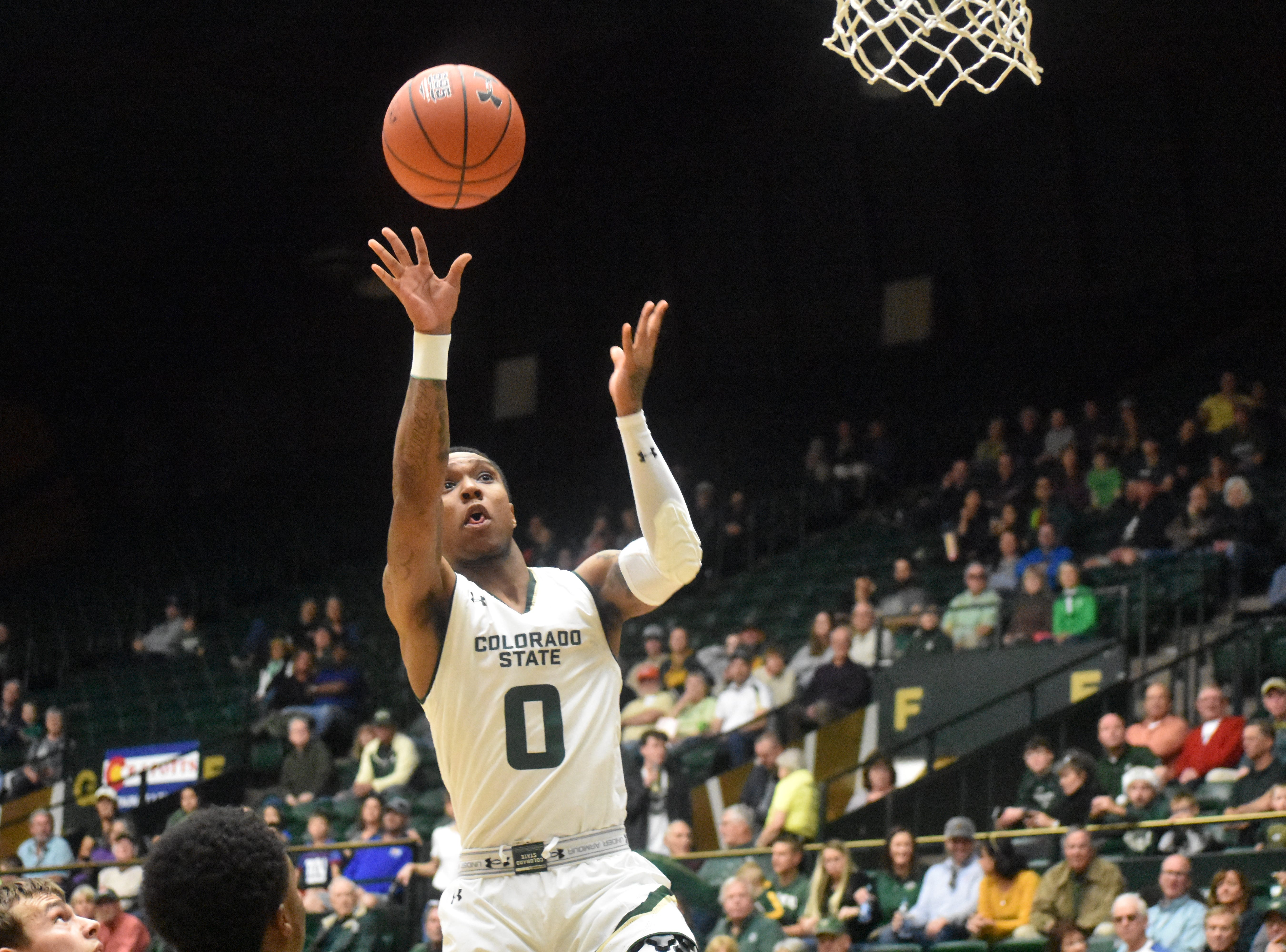 CSU guard Hyron Edwards attempts a shot against South Dakota on Sunday at Moby Arena.