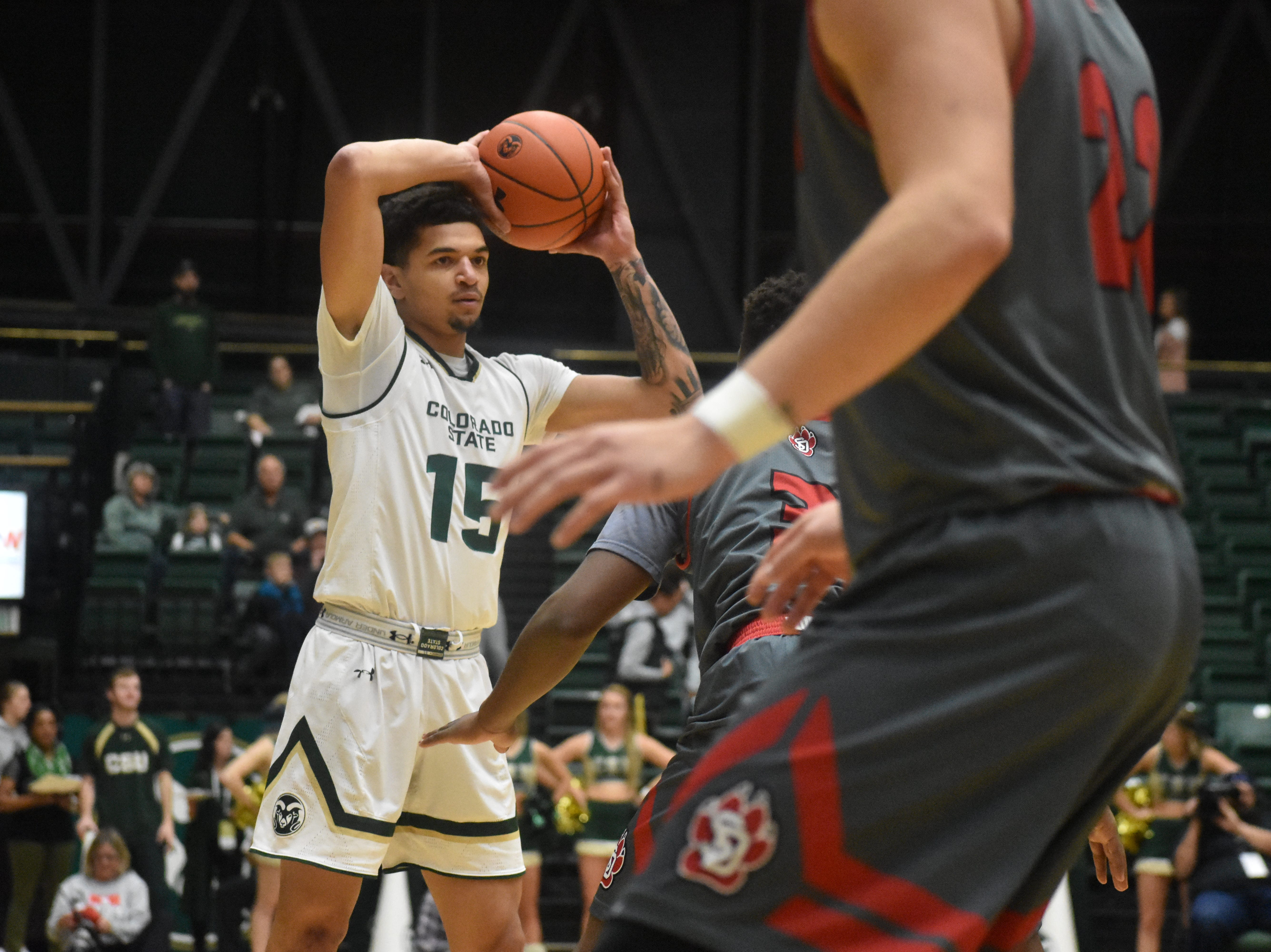 CSU guard Anthony Masinton-Bonner looks for a pass during Sunday's game against South Dakota at Moby Arena.