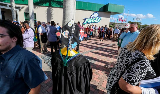 Sissi Lopez Diaz Jensen looks for her family outside the arena. TheÊjourney Sissi Lopez Diaz Jensen took that culminated in her walking across the stage for FGCU's fall commencement at Alico Arena on Sunday, diploma in hand, has been aÊlong one. That journey that started in Cuba, with a stop in Denmark, and brought her toÊthe United States at age 7 is what prompted her to focus her studies on political science and look to the future andÊpursueÊa career in law, and a dedication to public service.