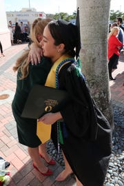 Sissi hugs her mother, Mariana Lopez Diaz, now of Miami, after graduating from FGCU. TheÊjourney Sissi Lopez Diaz Jensen took that culminated in her walking across the stage for FGCU's fall commencement at Alico Arena on Sunday, diploma in hand, has been aÊlong one. That journey that started in Cuba, with a stop in Denmark, and brought her toÊthe United States at age 7 is what prompted her to focus her studies on political science and look to the future andÊpursueÊa career in law, and a dedication to public service.