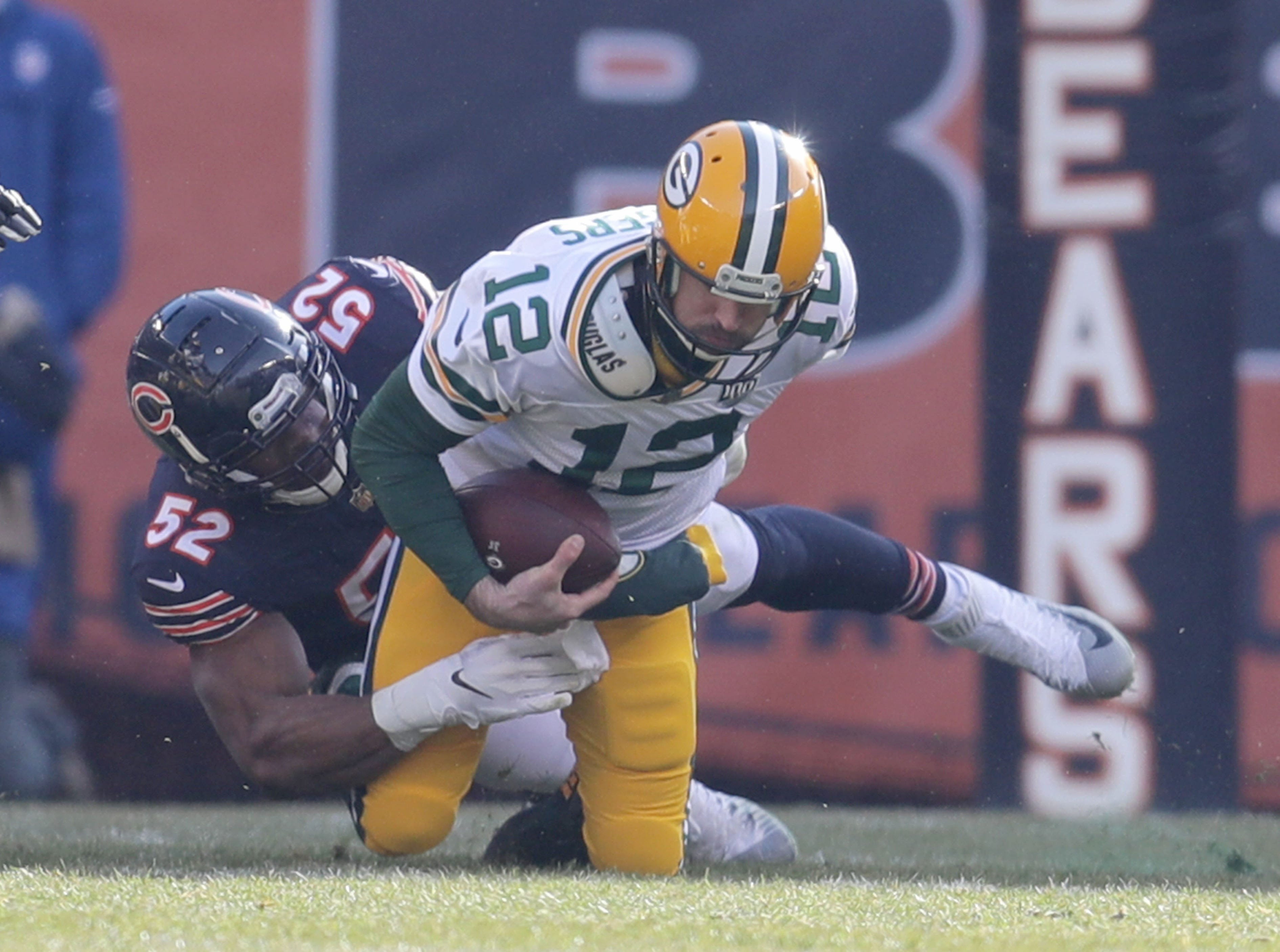 Green Bay Packers' Aaron Rodgers is sacked by Chicago Bears' Khalil Mack during the 1st half of the Green Bay Packers game against the Chicago Bears at Soldier Field Sunday, Dec. 16, 2018, in Chicago.