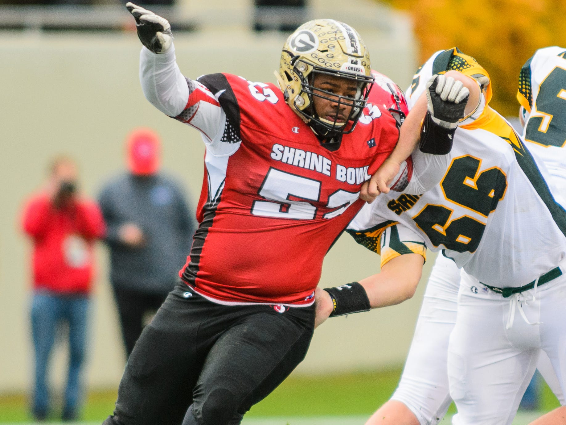 Greer defensive lineman Quack Cohen (53) rushes the quarterback during the 82nd Shrine Bowl of the Carolinas Saturday at Wofford's Gibbs Stadium.