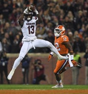 South Carolina wide receiver Shi Smith (13) makes a reception past Clemson defensive back K'Von Wallace (12) during the 1st quarter Saturday, November 24, 2018 at Clemson's Memorial Stadium.