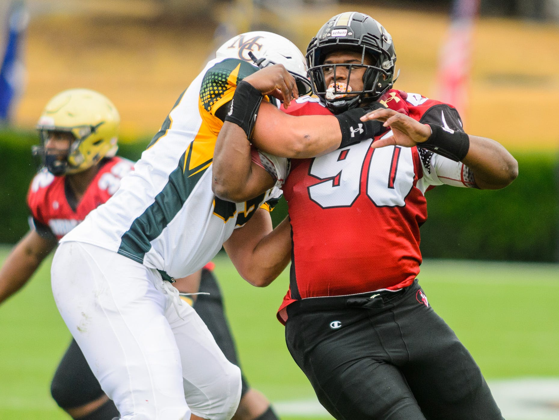 T.L. Hanna defensive lineman Zacch Pickens (90) tries to get around a blocker during the 82nd annual Shrine Bowl of the Carolinas on Saturday, December 15, 2018 at Wofford's Gibbs Stadium in Spartanburg, SC.