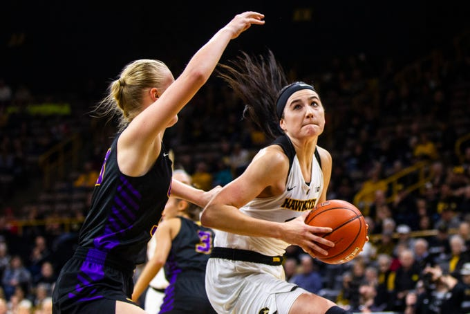 Iowa forward Megan Gustafson (10) drives to the hoop during a NCAA women's basketball game on Sunday, Dec. 16, 2018, at Carver-Hawkeye Arena in Iowa City.