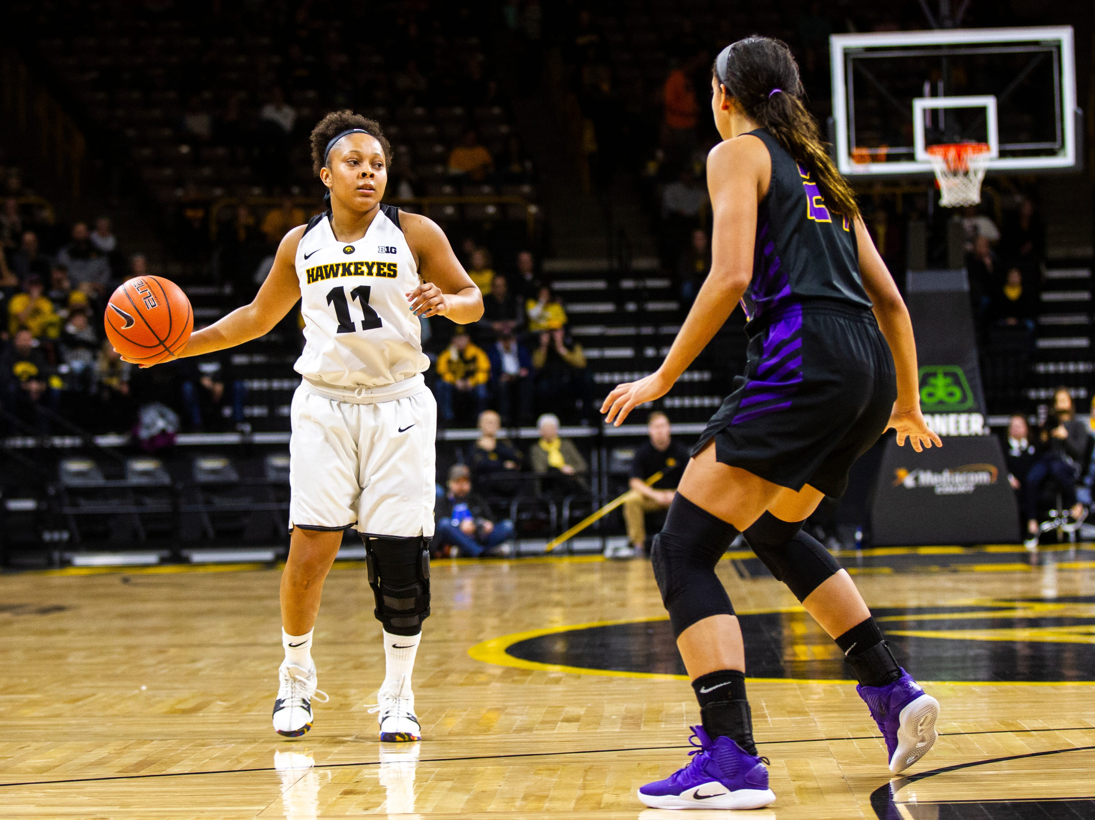Iowa guard Tania Davis (11) takes the ball up court during a NCAA women's basketball game on Sunday, Dec. 16, 2018, at Carver-Hawkeye Arena in Iowa City.