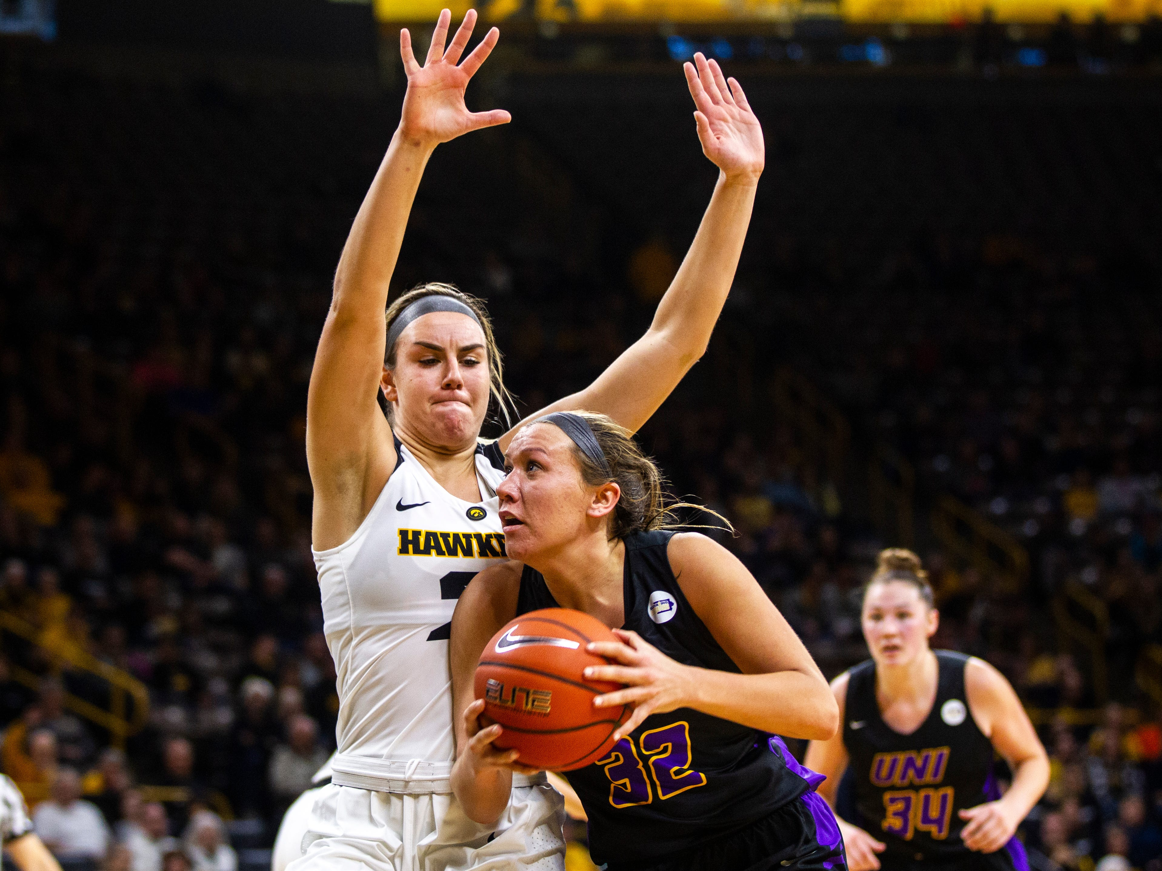 Iowa forward Hannah Stewart (21) defends Northern Iowa forward Heidi Hillyard (32) during a NCAA women's basketball game on Sunday, Dec. 16, 2018, at Carver-Hawkeye Arena in Iowa City.