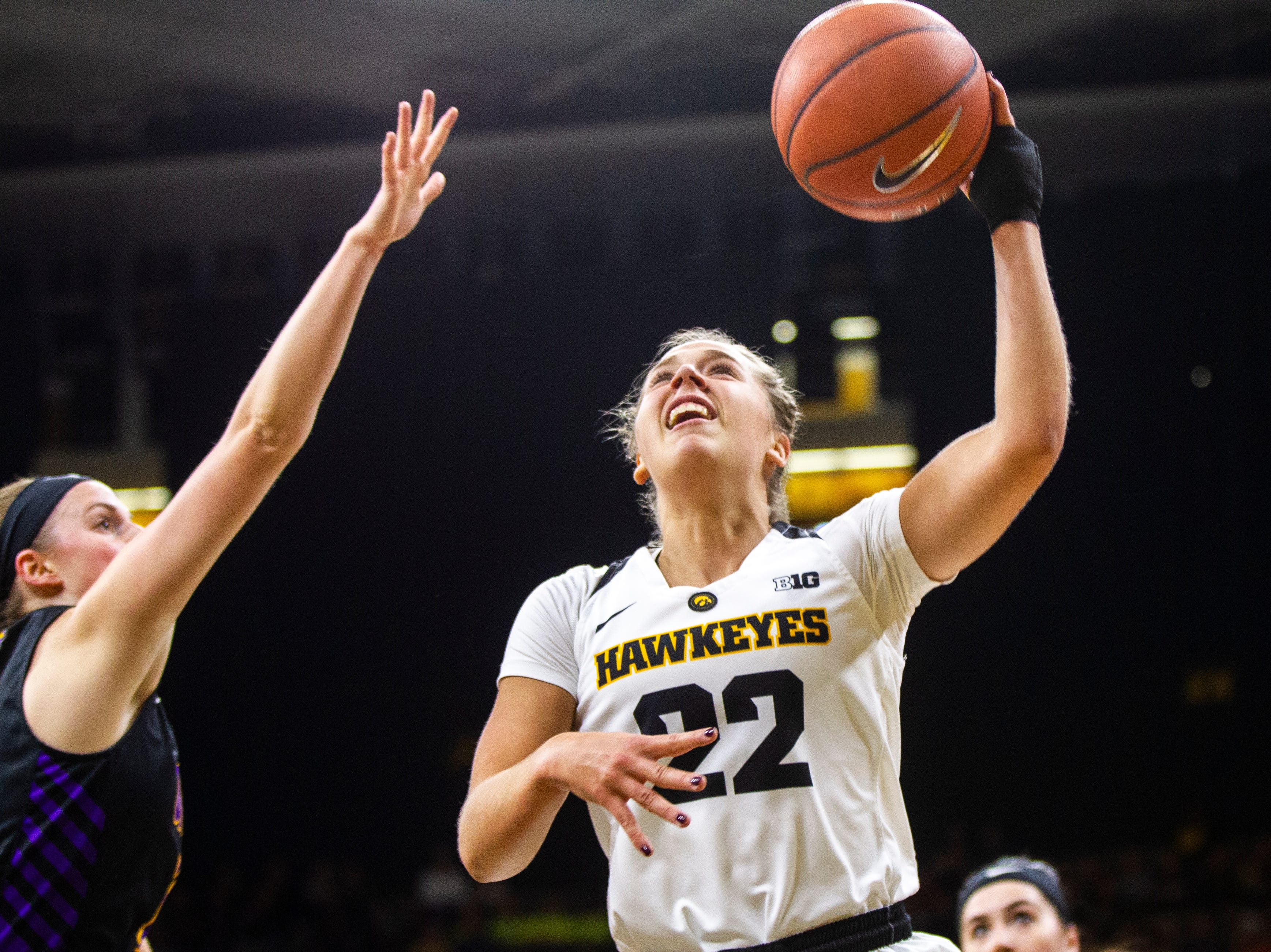 Iowa guard Kathleen Doyle (22) attempts a layup during a NCAA women's basketball game on Sunday, Dec. 16, 2018, at Carver-Hawkeye Arena in Iowa City.