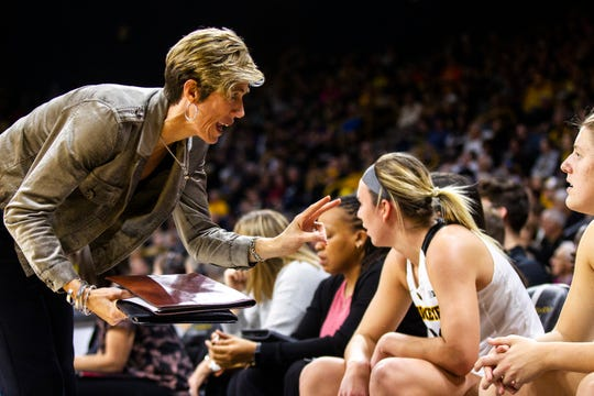 Iowa associate coach Jan Jensen talks with Iowa's Monika Czinano during a NCAA women's basketball game on Sunday, Dec. 16, 2018, at Carver-Hawkeye Arena in Iowa City.