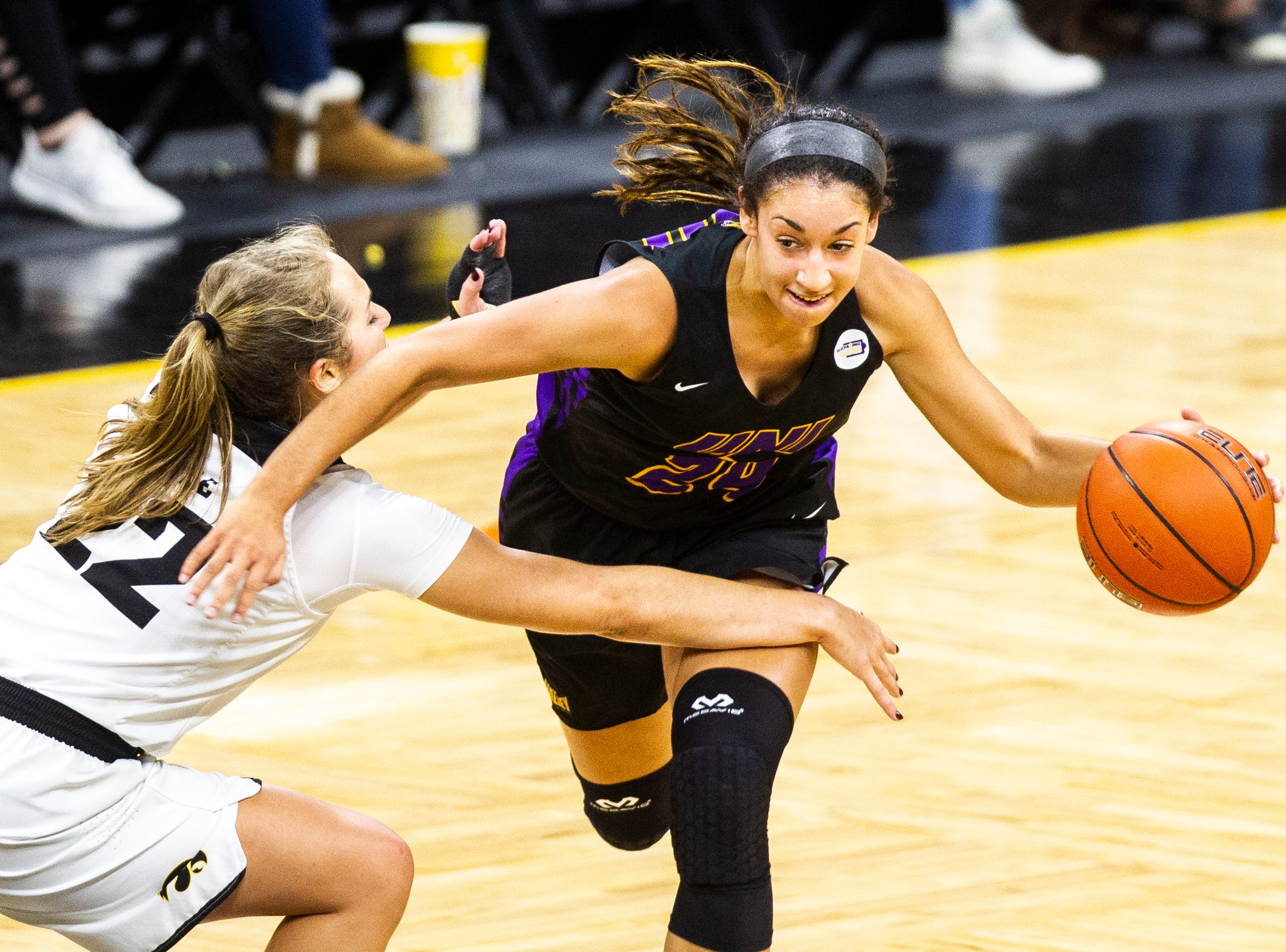 Northern Iowa guard Mikaela Morgan (24) drives past Iowa guard Kathleen Doyle (22) during a NCAA women's basketball game on Sunday, Dec. 16, 2018, at Carver-Hawkeye Arena in Iowa City.