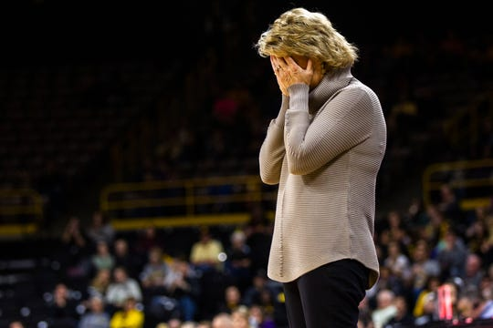 Iowa head coach Lisa Bluder covers her face while reacting to an official's call during a NCAA women's basketball game on Sunday, Dec. 16, 2018, at Carver-Hawkeye Arena in Iowa City.