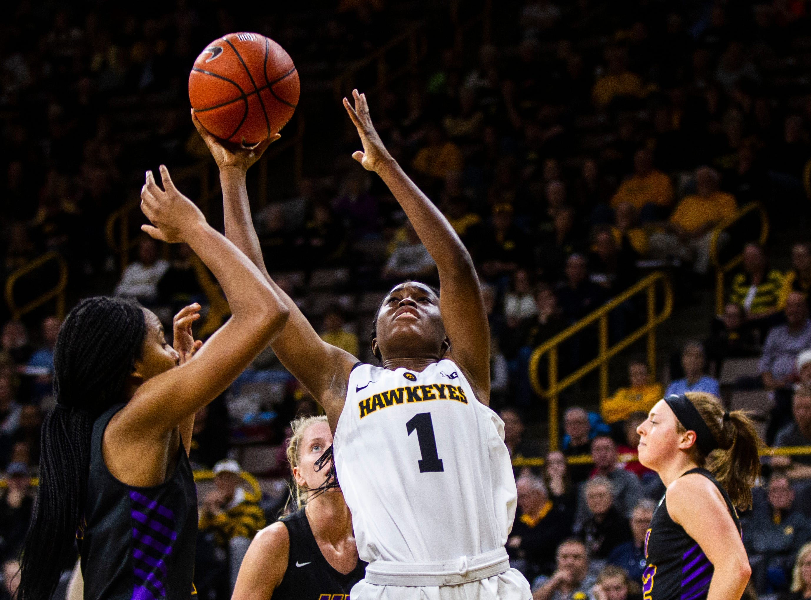 Iowa guard Tomi Taiwo (1) gets fouled during a NCAA women's basketball game on Sunday, Dec. 16, 2018, at Carver-Hawkeye Arena in Iowa City.