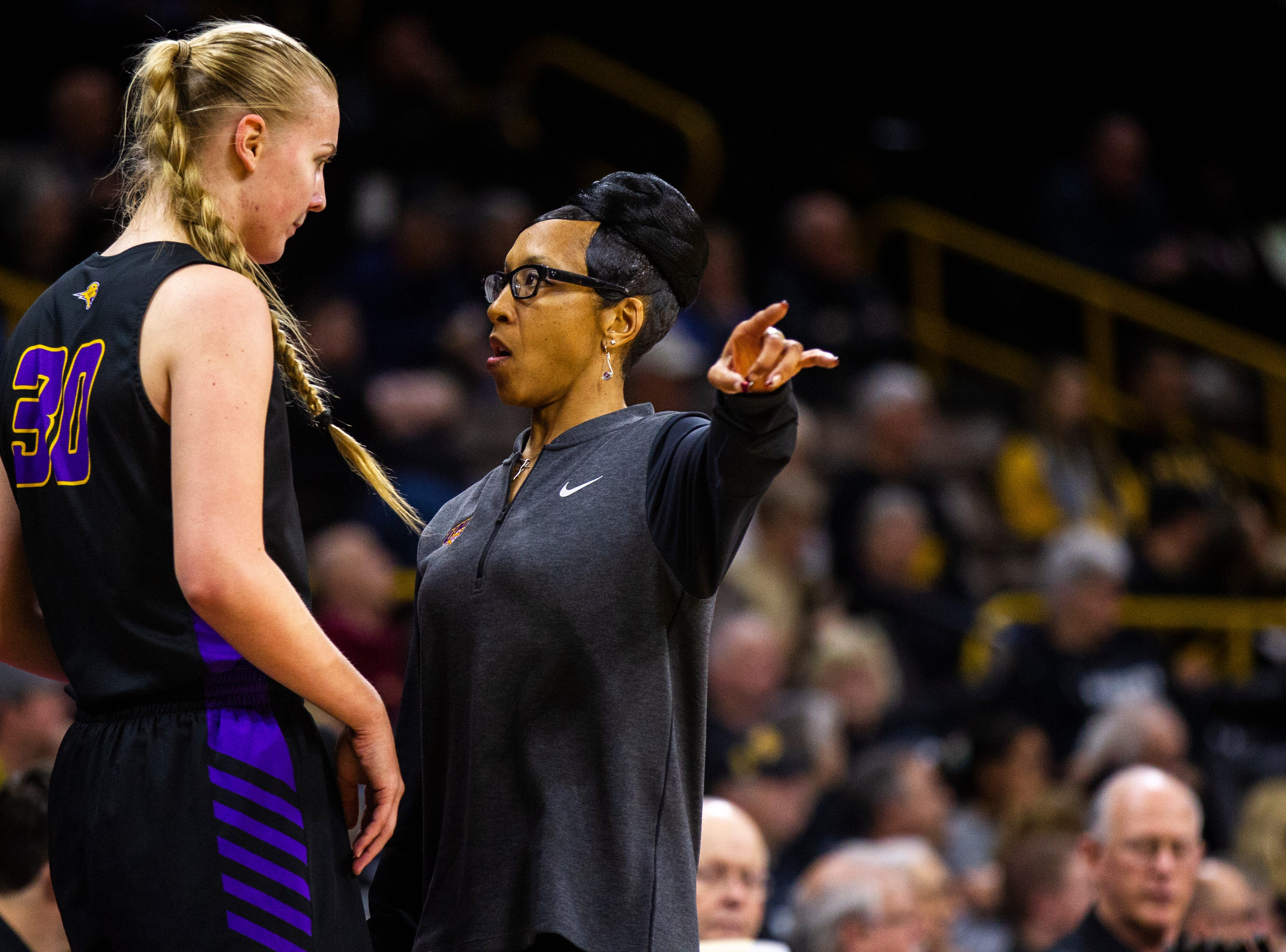 Northern Iowa head coach Tanya Warren talks with Northern Iowa center Cynthia Wolf (30) during a NCAA women's basketball game on Sunday, Dec. 16, 2018, at Carver-Hawkeye Arena in Iowa City.