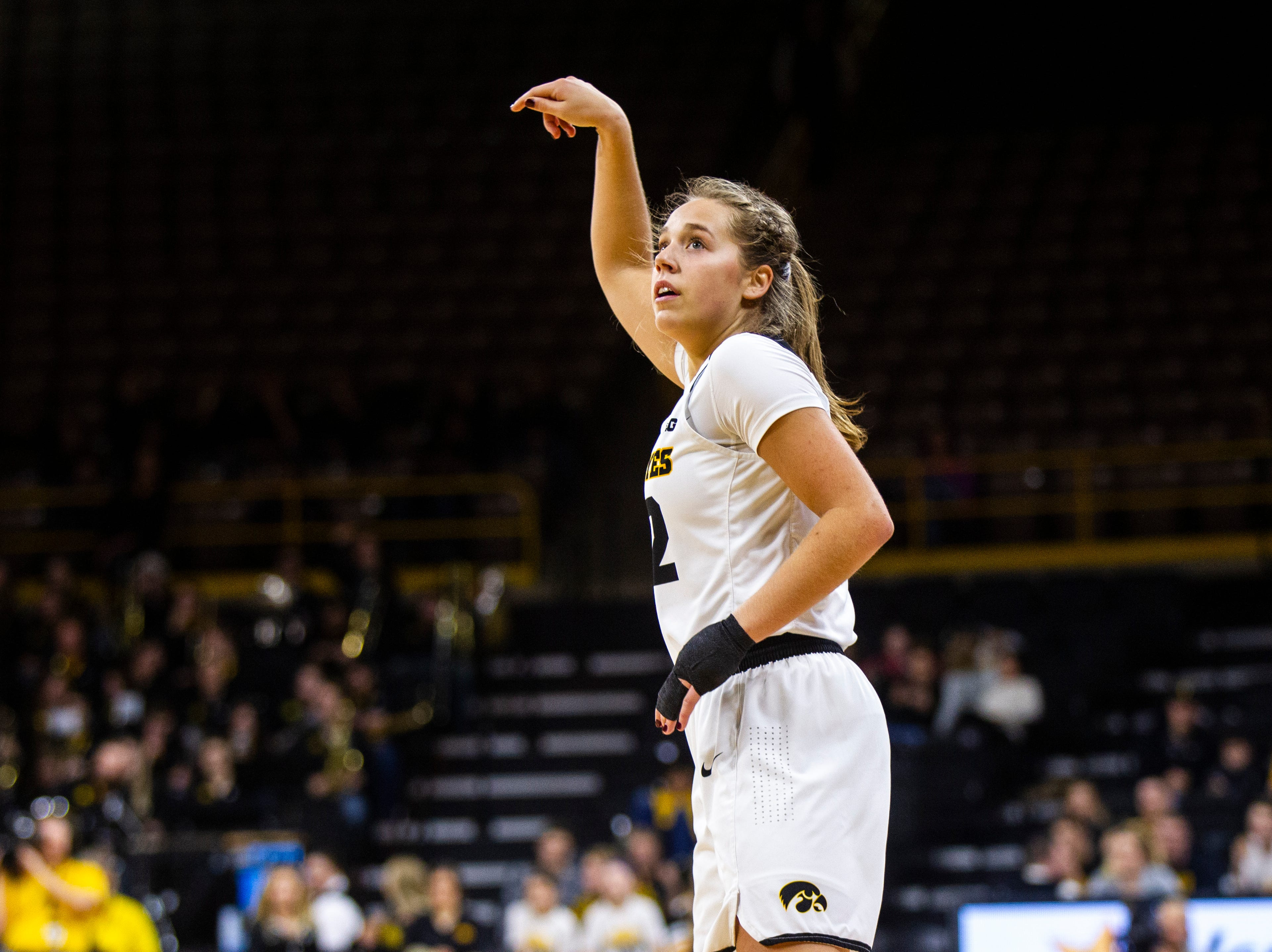 Iowa guard Kathleen Doyle (22) watches as her 3-point shot lands during a NCAA women's basketball game on Sunday, Dec. 16, 2018, at Carver-Hawkeye Arena in Iowa City.