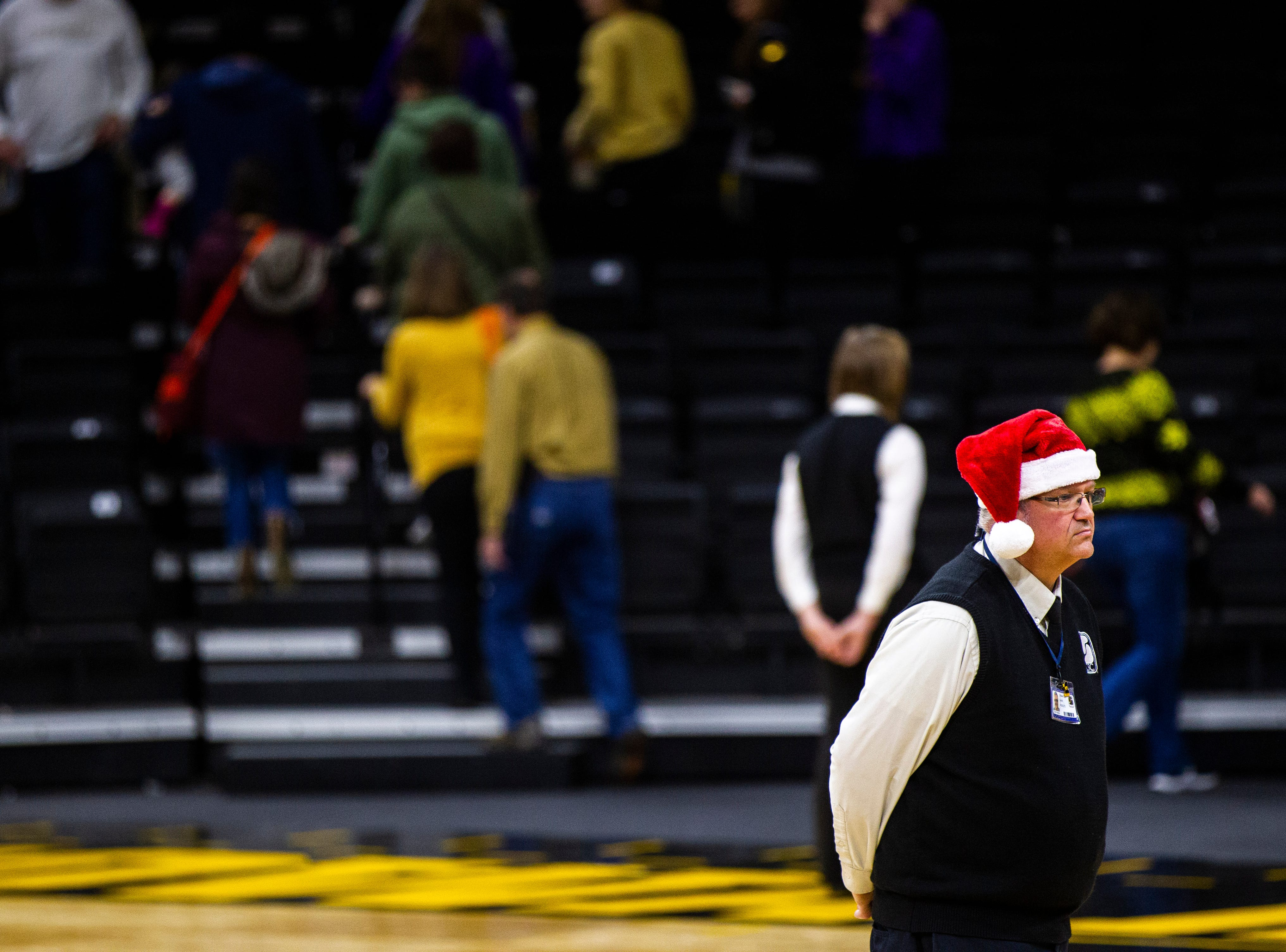 A CSC Security guard stands on the court after a NCAA women's basketball game on Sunday, Dec. 16, 2018, at Carver-Hawkeye Arena in Iowa City.