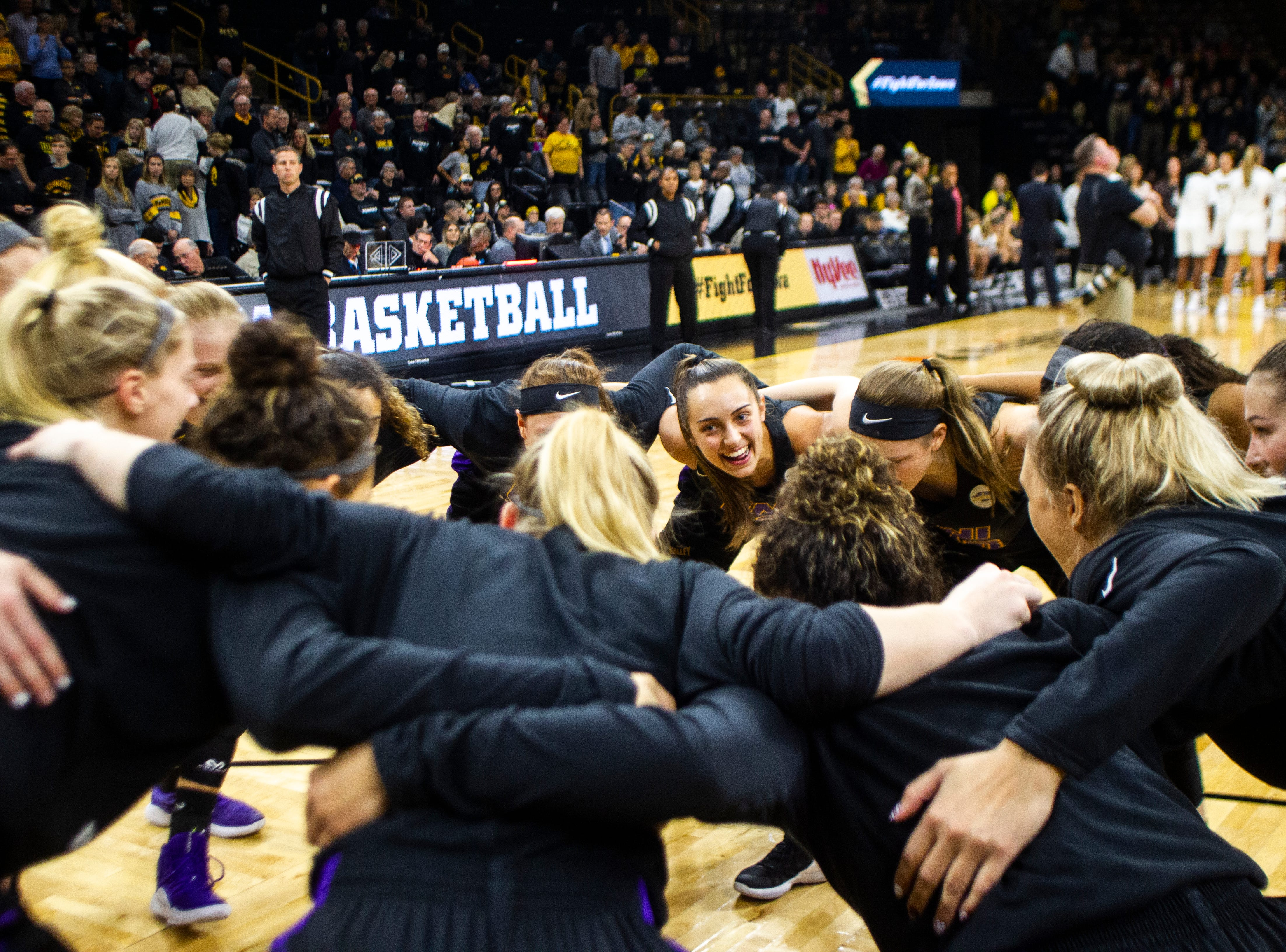 Northern Iowa guard Karli Rucker (3) huddles with teammates before a NCAA women's basketball game on Sunday, Dec. 16, 2018, at Carver-Hawkeye Arena in Iowa City.