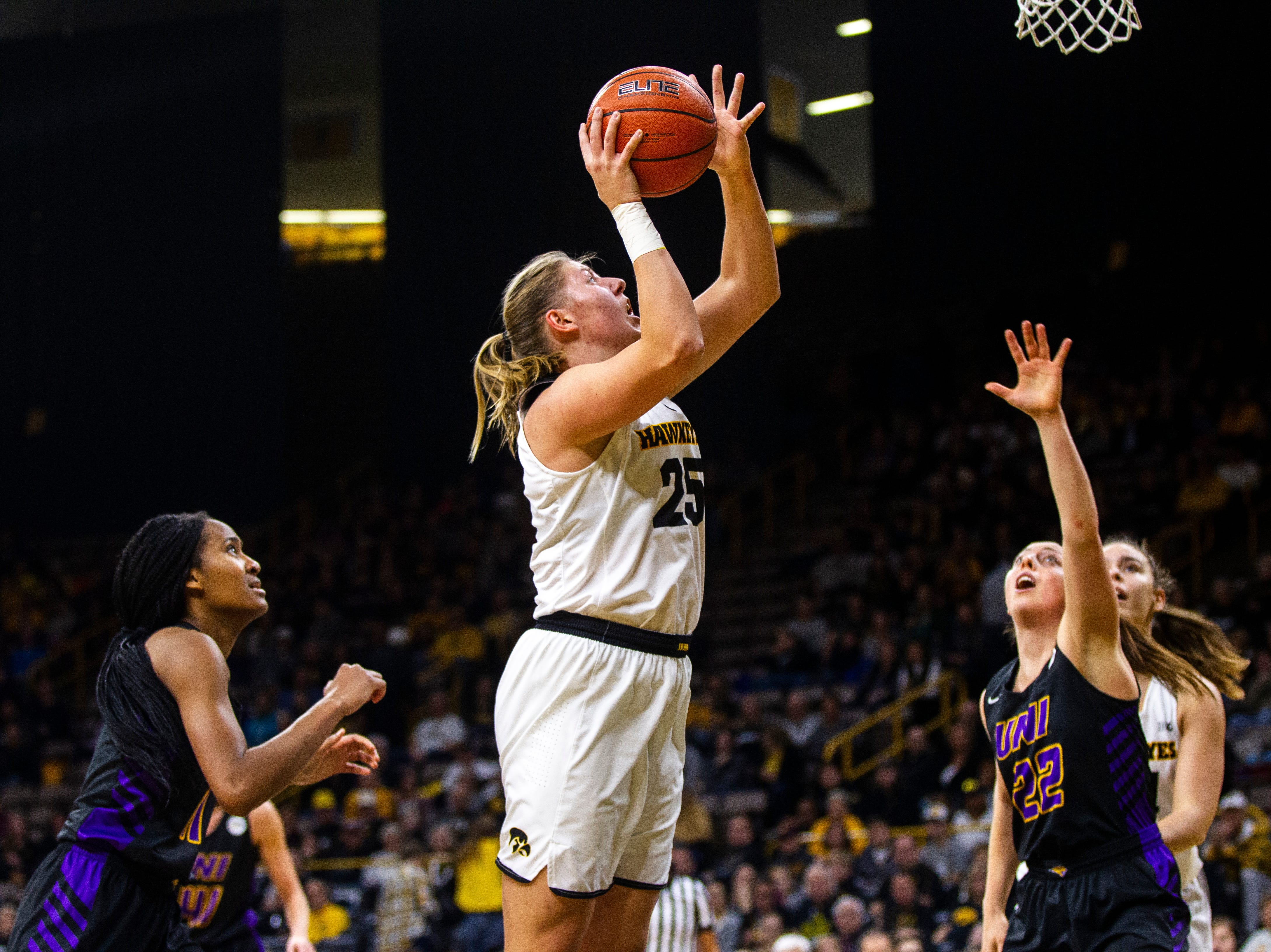 Iowa's Monika Czinano (25) attempts a basket during a NCAA women's basketball game on Sunday, Dec. 16, 2018, at Carver-Hawkeye Arena in Iowa City.
