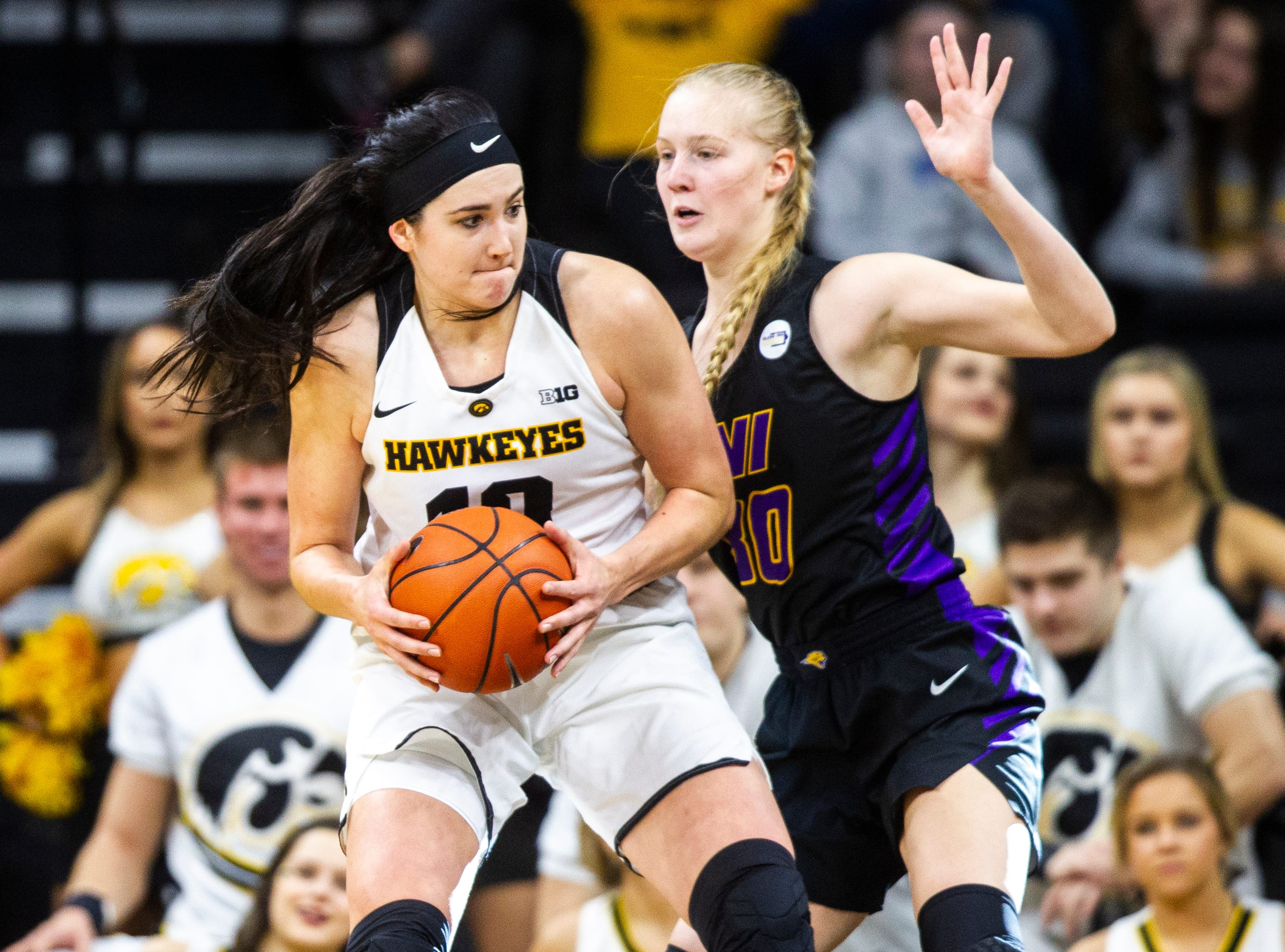 Iowa forward Megan Gustafson (10) gets defended by Northern Iowa center Cynthia Wolf (30) during a NCAA women's basketball game on Sunday, Dec. 16, 2018, at Carver-Hawkeye Arena in Iowa City.