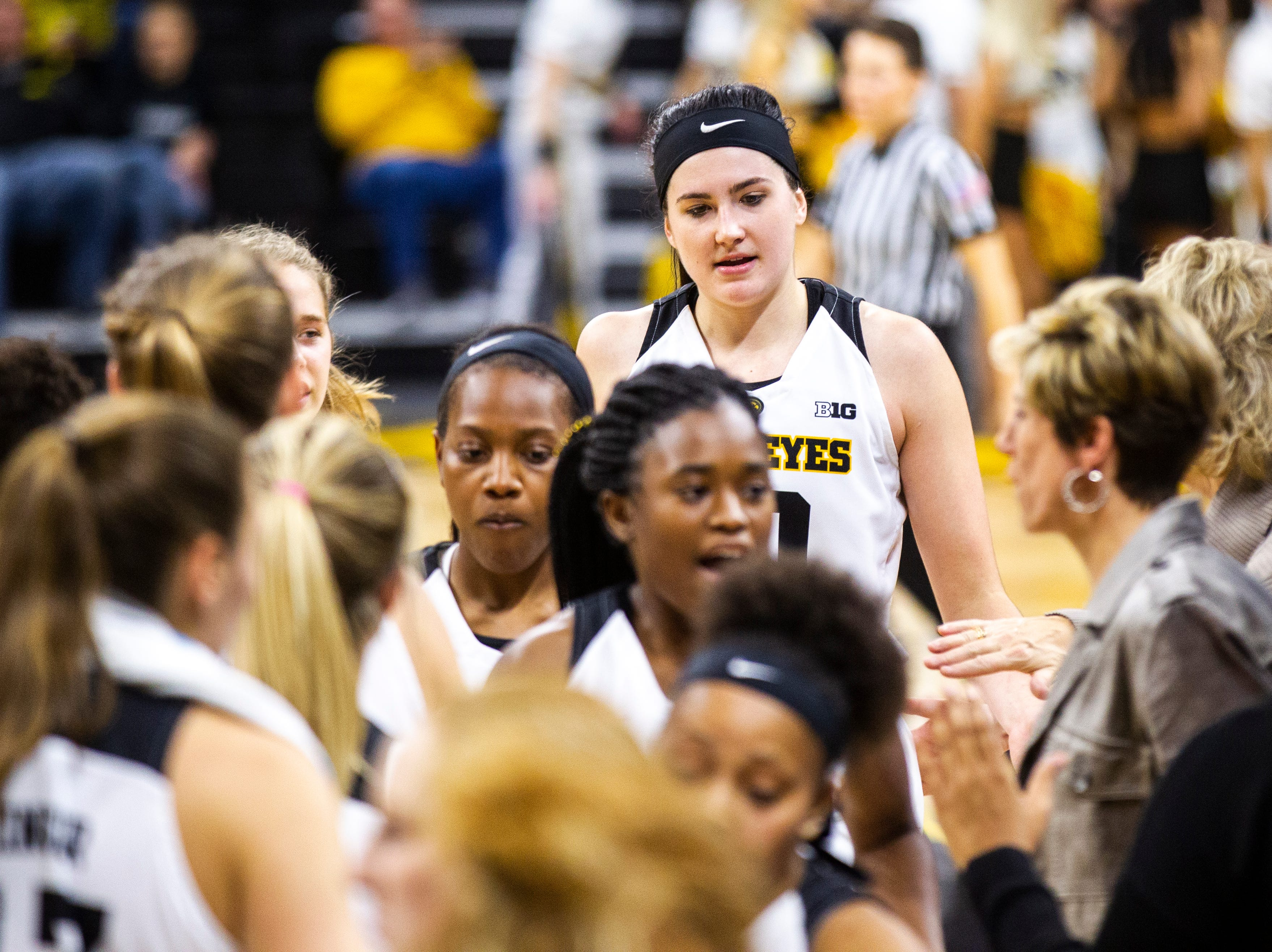 Iowa forward Megan Gustafson (10) huddles up with teammates heading into a timeout during a NCAA women's basketball game on Sunday, Dec. 16, 2018, at Carver-Hawkeye Arena in Iowa City.