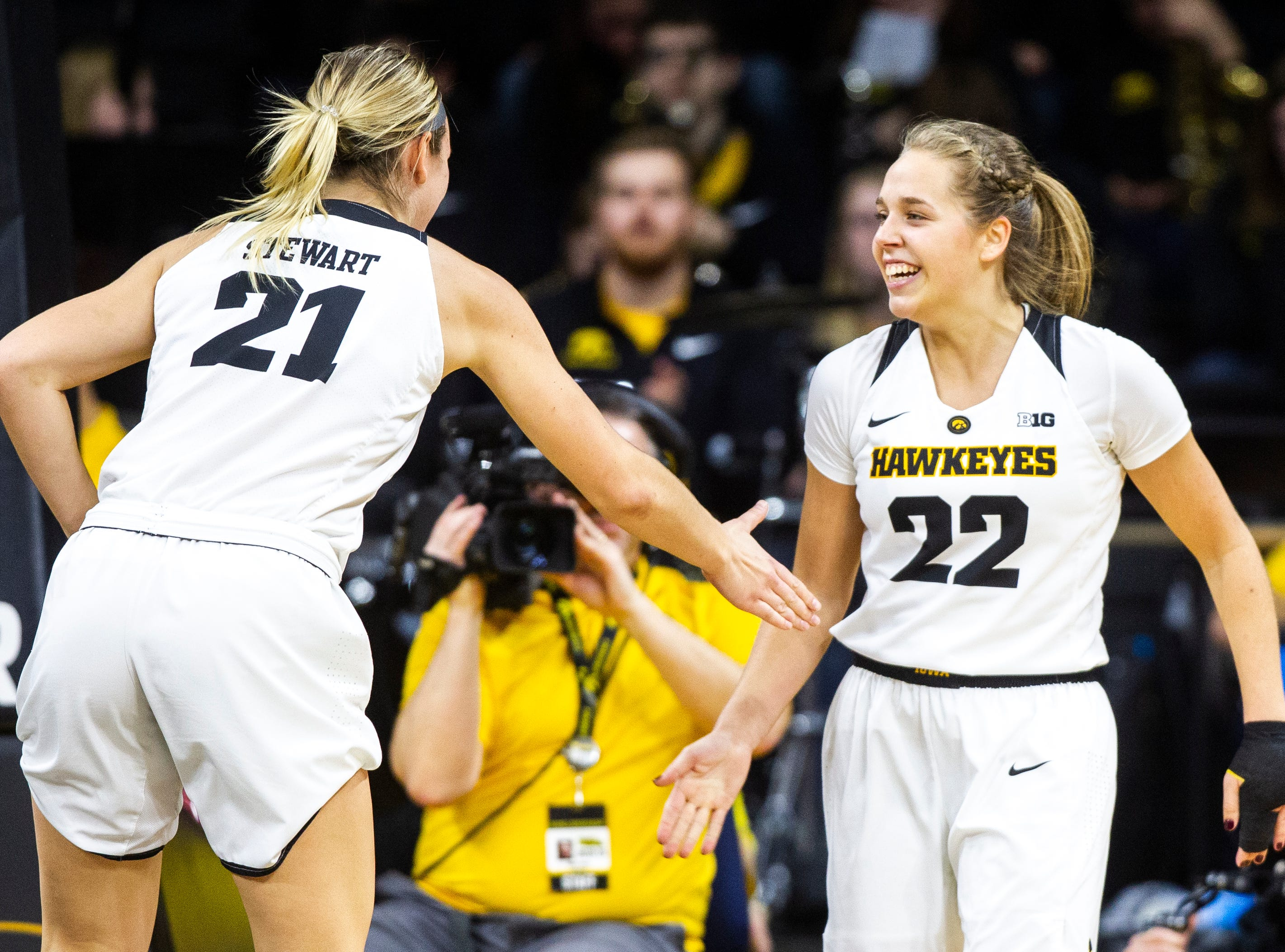 Iowa guard Kathleen Doyle (22) gets a high-five from Iowa forward Hannah Stewart (21) during a NCAA women's basketball game on Sunday, Dec. 16, 2018, at Carver-Hawkeye Arena in Iowa City.