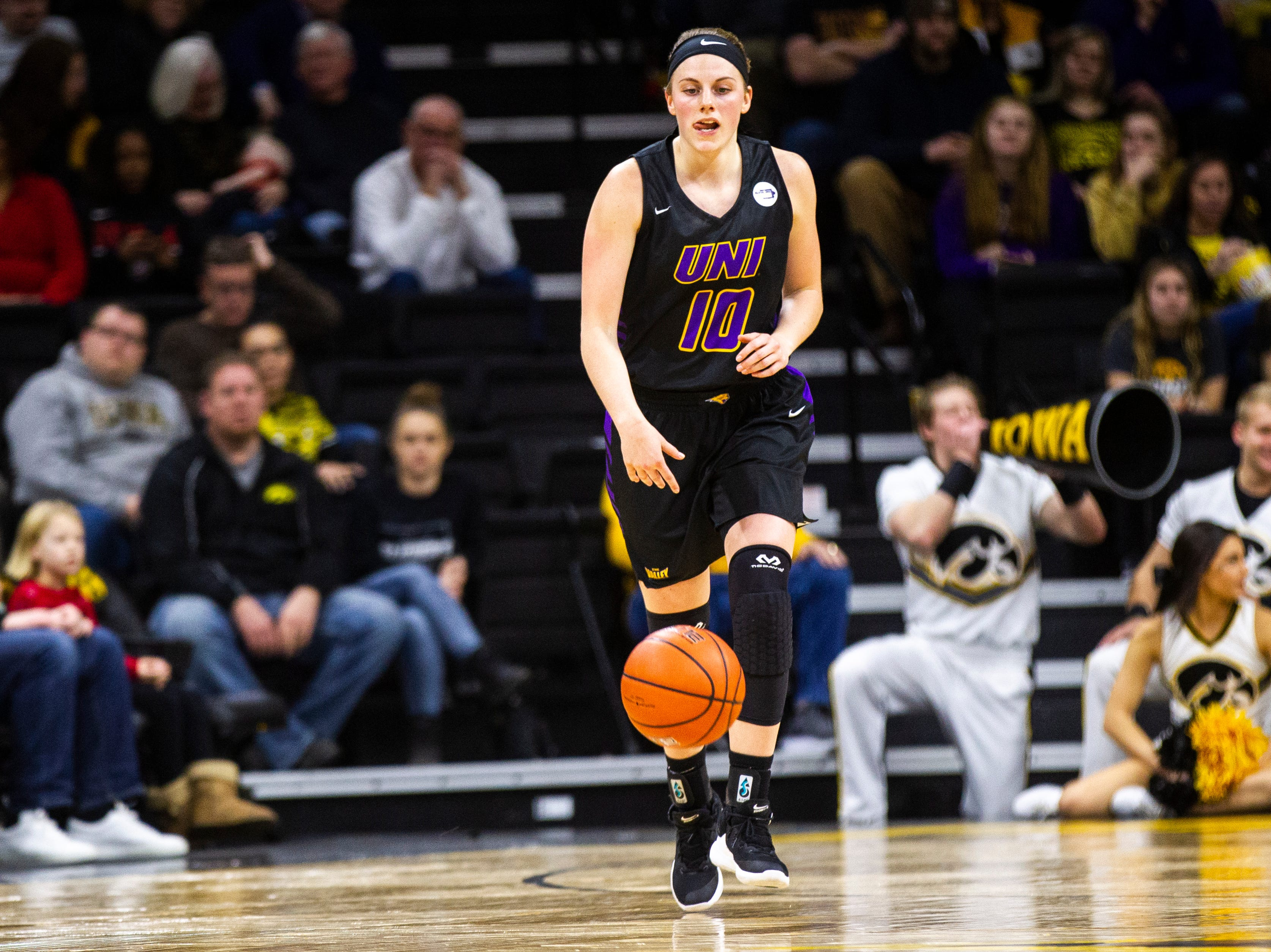 Northern Iowa guard Ellie Howell (10) takes the ball up court during a NCAA women's basketball game on Sunday, Dec. 16, 2018, at Carver-Hawkeye Arena in Iowa City.