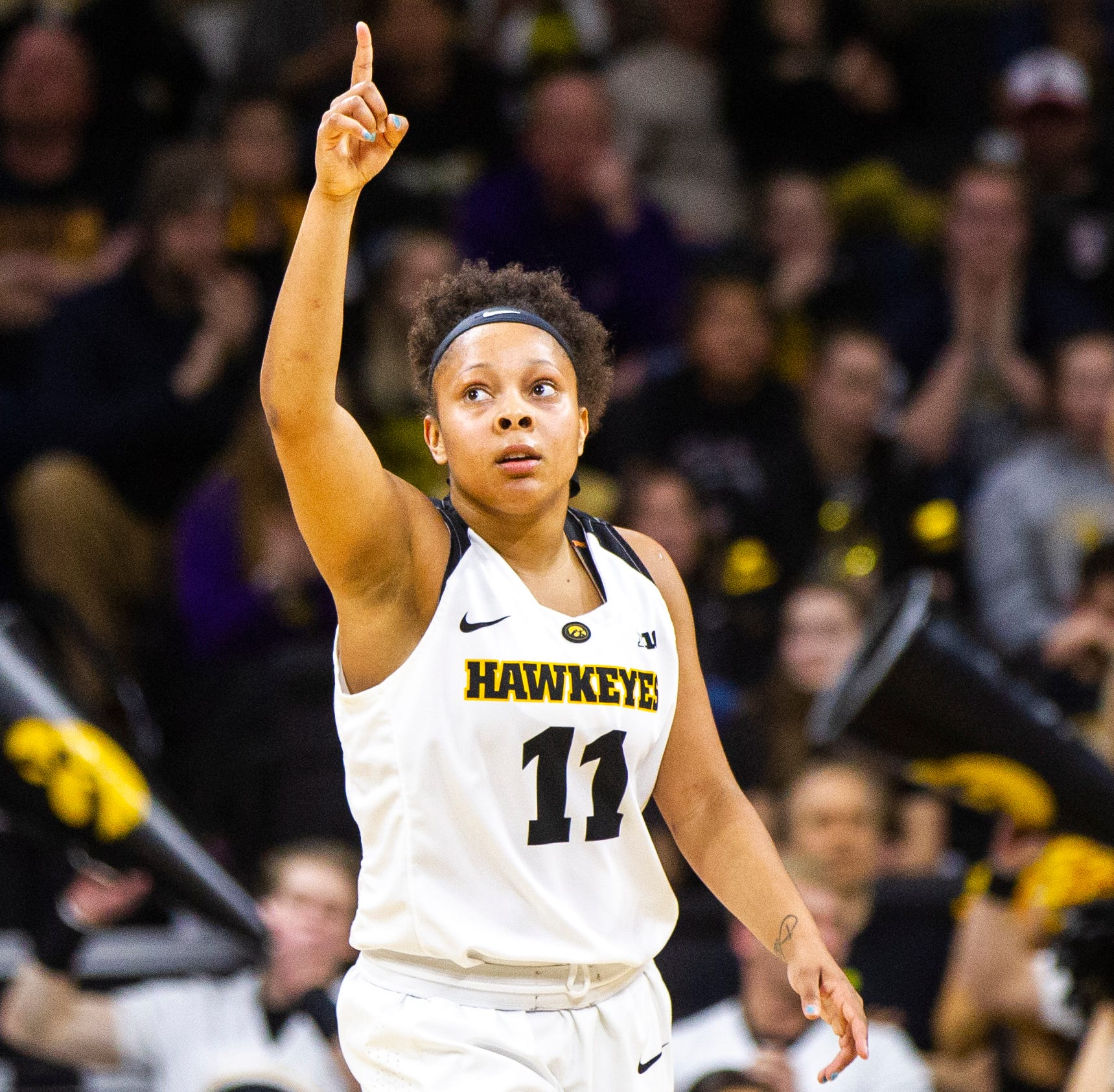 Iowa guard Tania Davis (11) celebrates after...