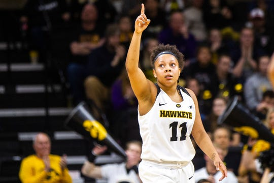 Iowa guard Tania Davis (11) celebrates after making a 3-point basket during a NCAA women's basketball game on Sunday, Dec. 16, 2018, at Carver-Hawkeye Arena in Iowa City.