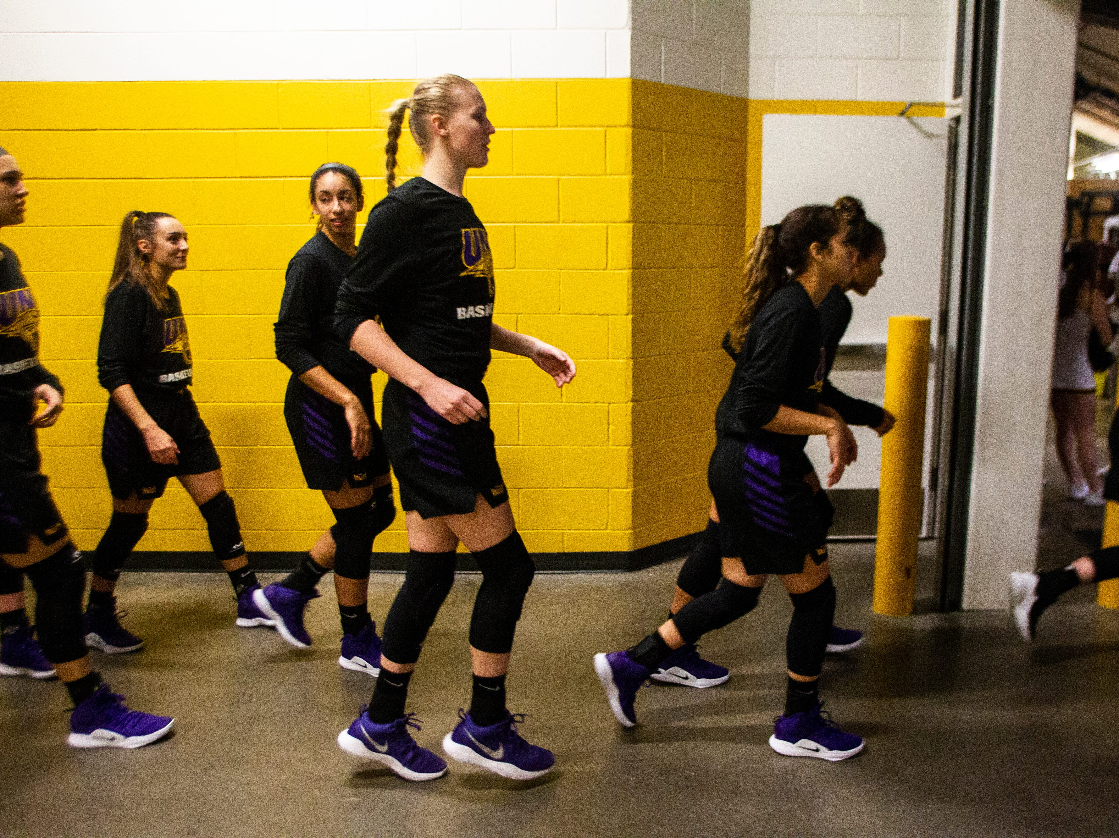 Northern Iowa Panthers run out onto the court during a NCAA women's basketball game on Sunday, Dec. 16, 2018, at Carver-Hawkeye Arena in Iowa City.