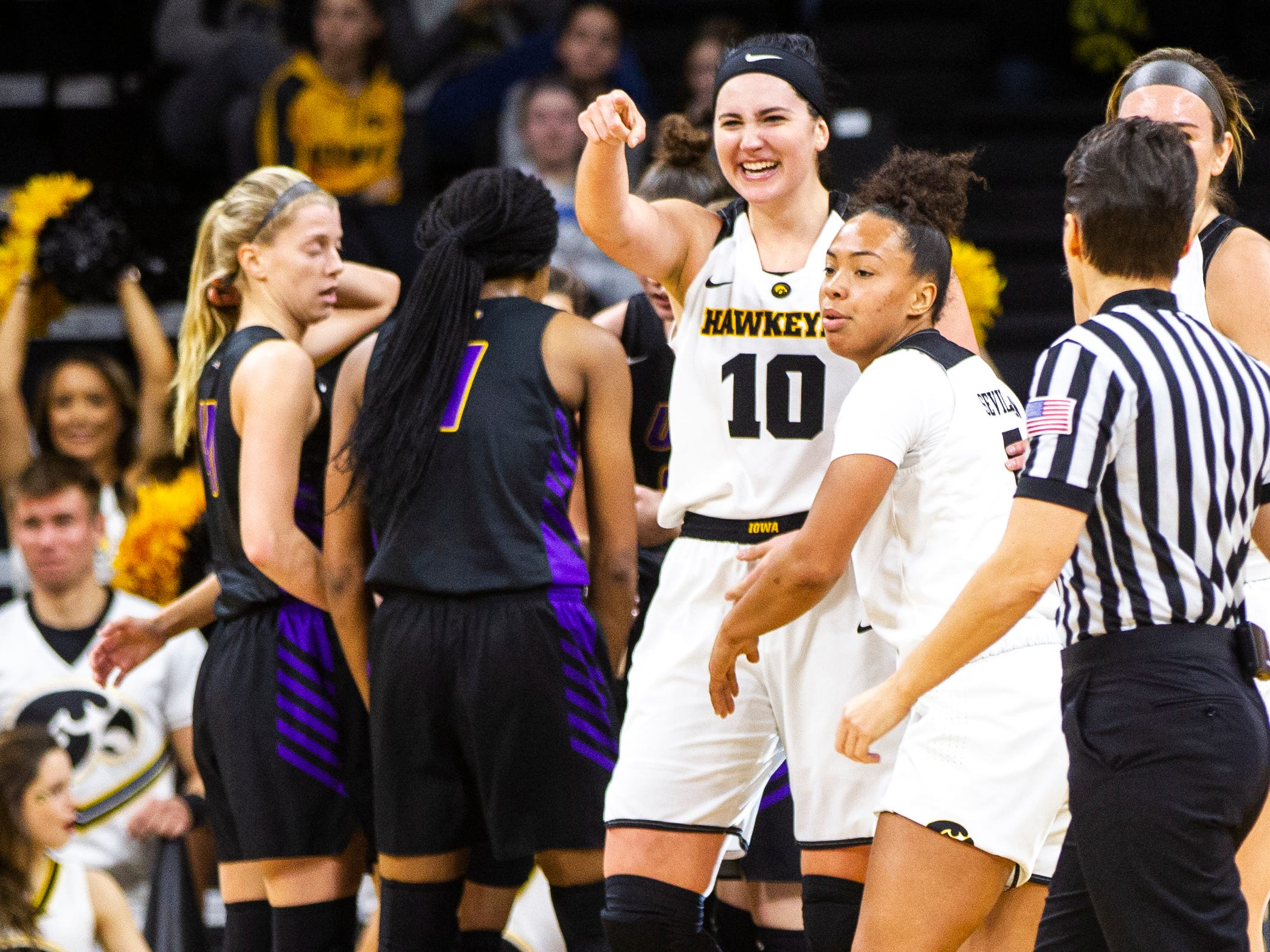 Iowa forward Megan Gustafson (10) celebrates after drawing a foul during a NCAA women's basketball game on Sunday, Dec. 16, 2018, at Carver-Hawkeye Arena in Iowa City.