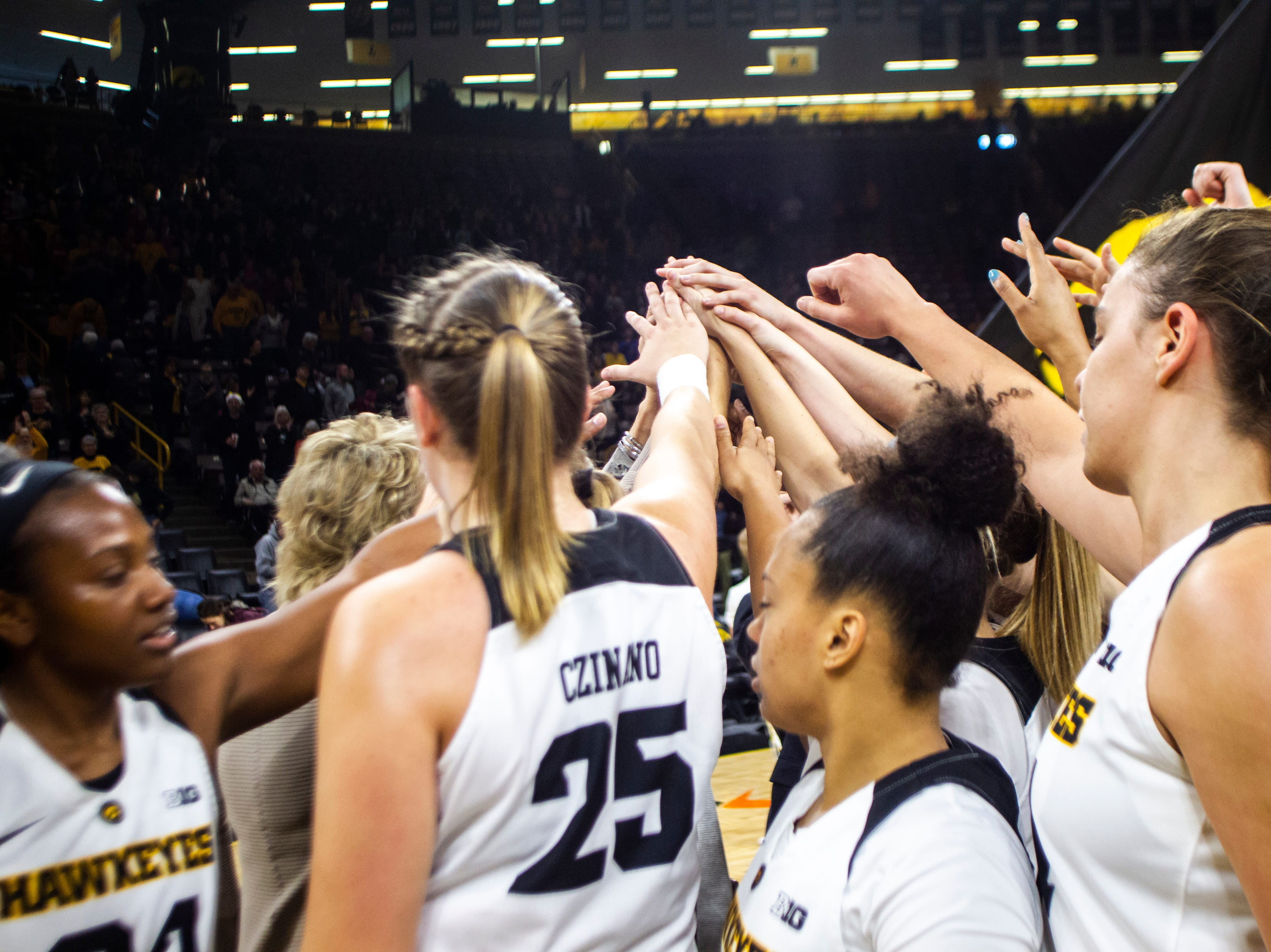Iowa Hawkeyes players huddle after a NCAA women's basketball game on Sunday, Dec. 16, 2018, at Carver-Hawkeye Arena in Iowa City.