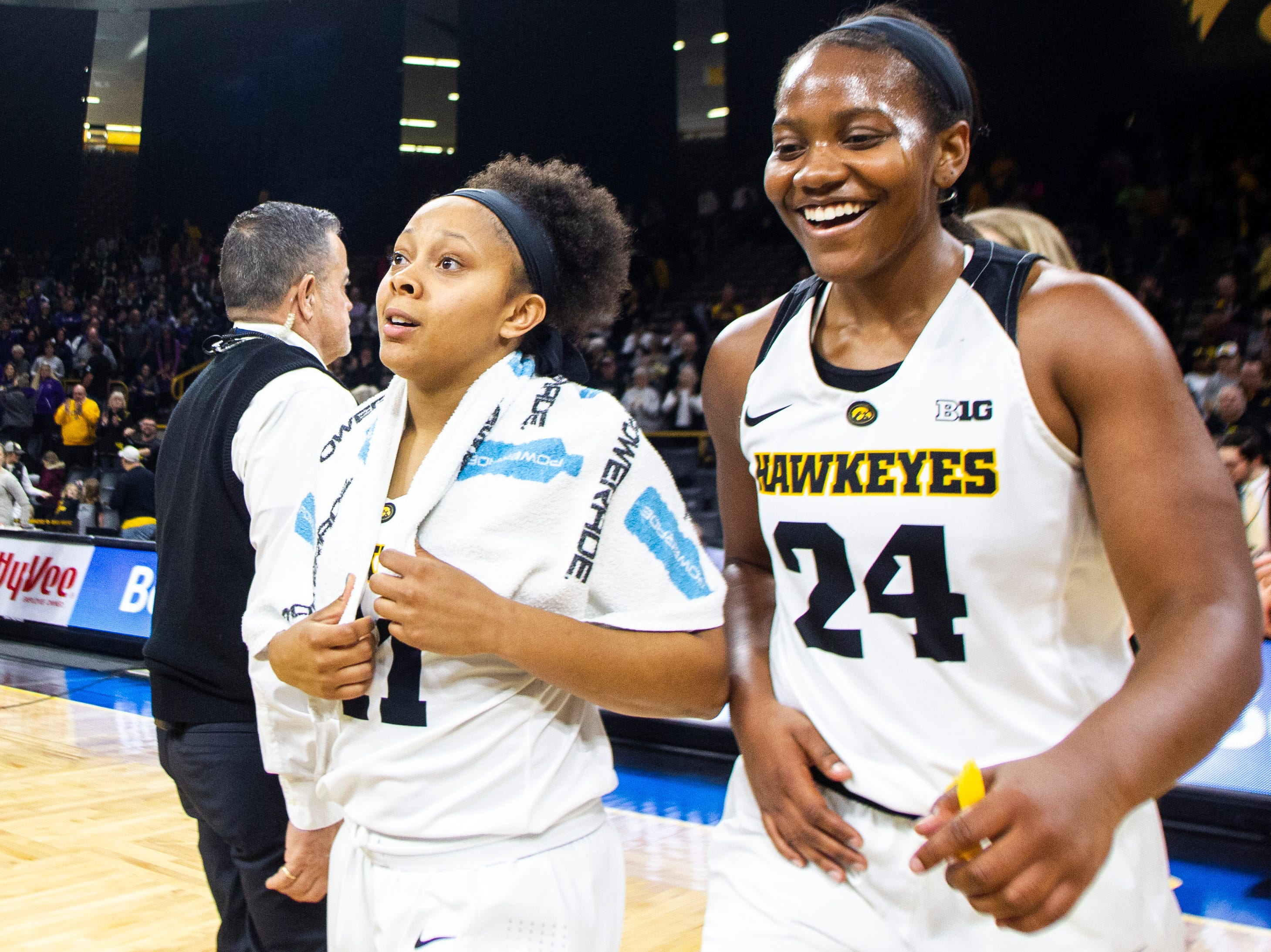 Iowa guard Tania Davis (11) and Iowa guard Zion Sanders (24) celebrate after a NCAA women's basketball game on Sunday, Dec. 16, 2018, at Carver-Hawkeye Arena in Iowa City.