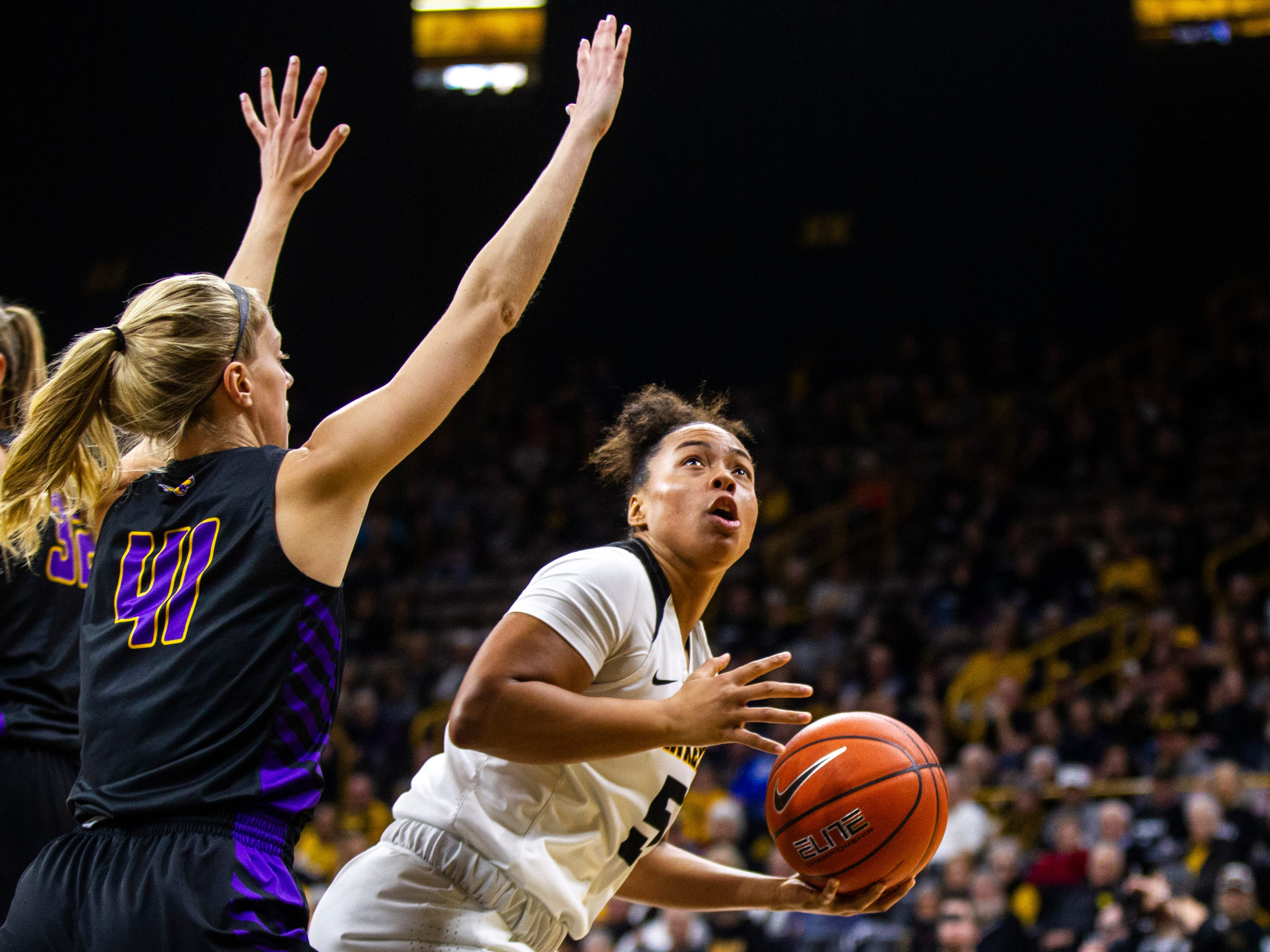 Iowa guard Alexis Sevillian (5) attempts a basket past Northern Iowa guard Abby Gerrits (41) during a NCAA women's basketball game on Sunday, Dec. 16, 2018, at Carver-Hawkeye Arena in Iowa City.