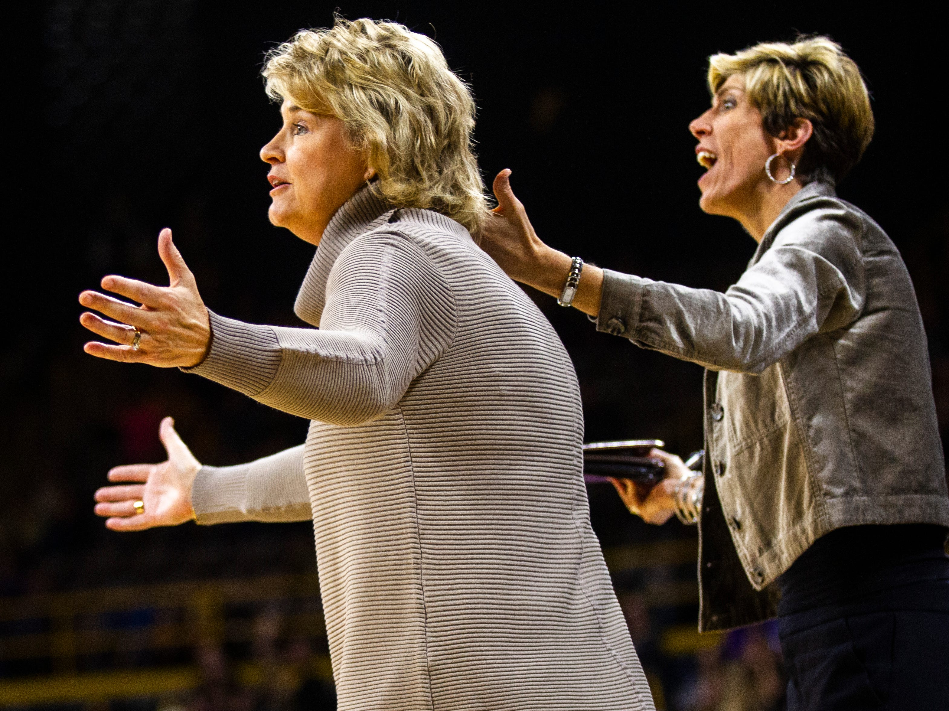 Iowa head coach Lisa Bluder, left, and associate Jan Jensen react to a call during a NCAA women's basketball game on Sunday, Dec. 16, 2018, at Carver-Hawkeye Arena in Iowa City.