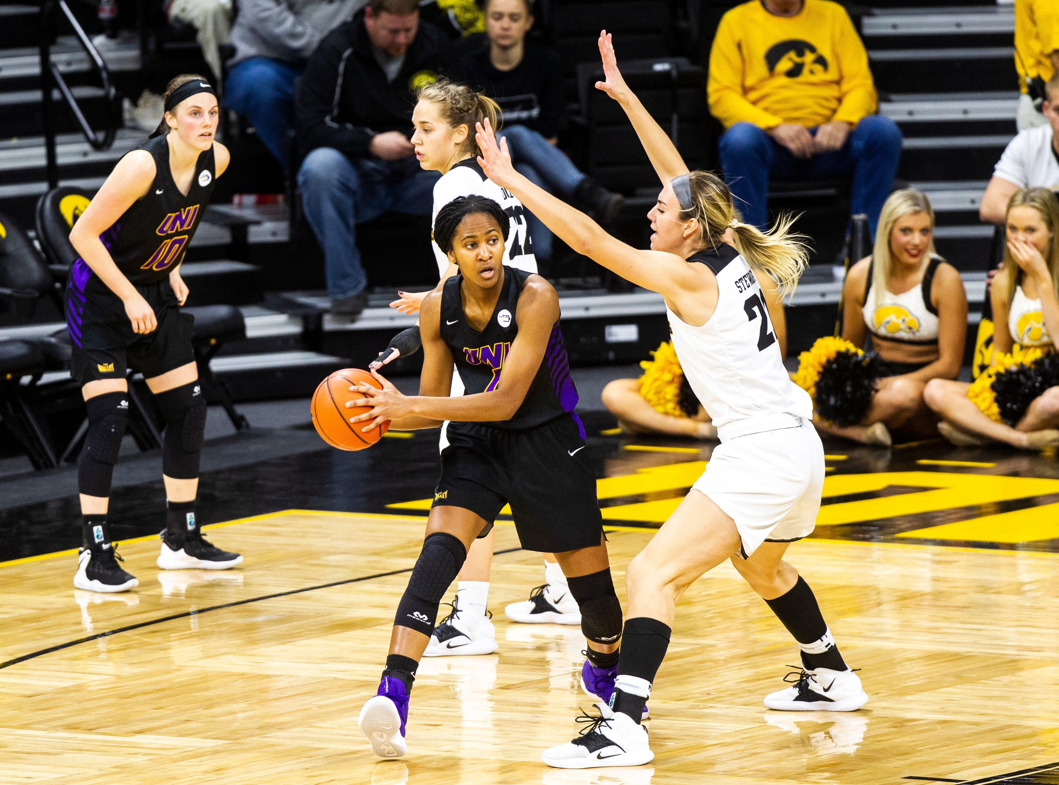 Northern Iowa forward Bre Gunnels (11) passes while being defended by Iowa forward Hannah Stewart (21) during a NCAA women's basketball game on Sunday, Dec. 16, 2018, at Carver-Hawkeye Arena in Iowa City.