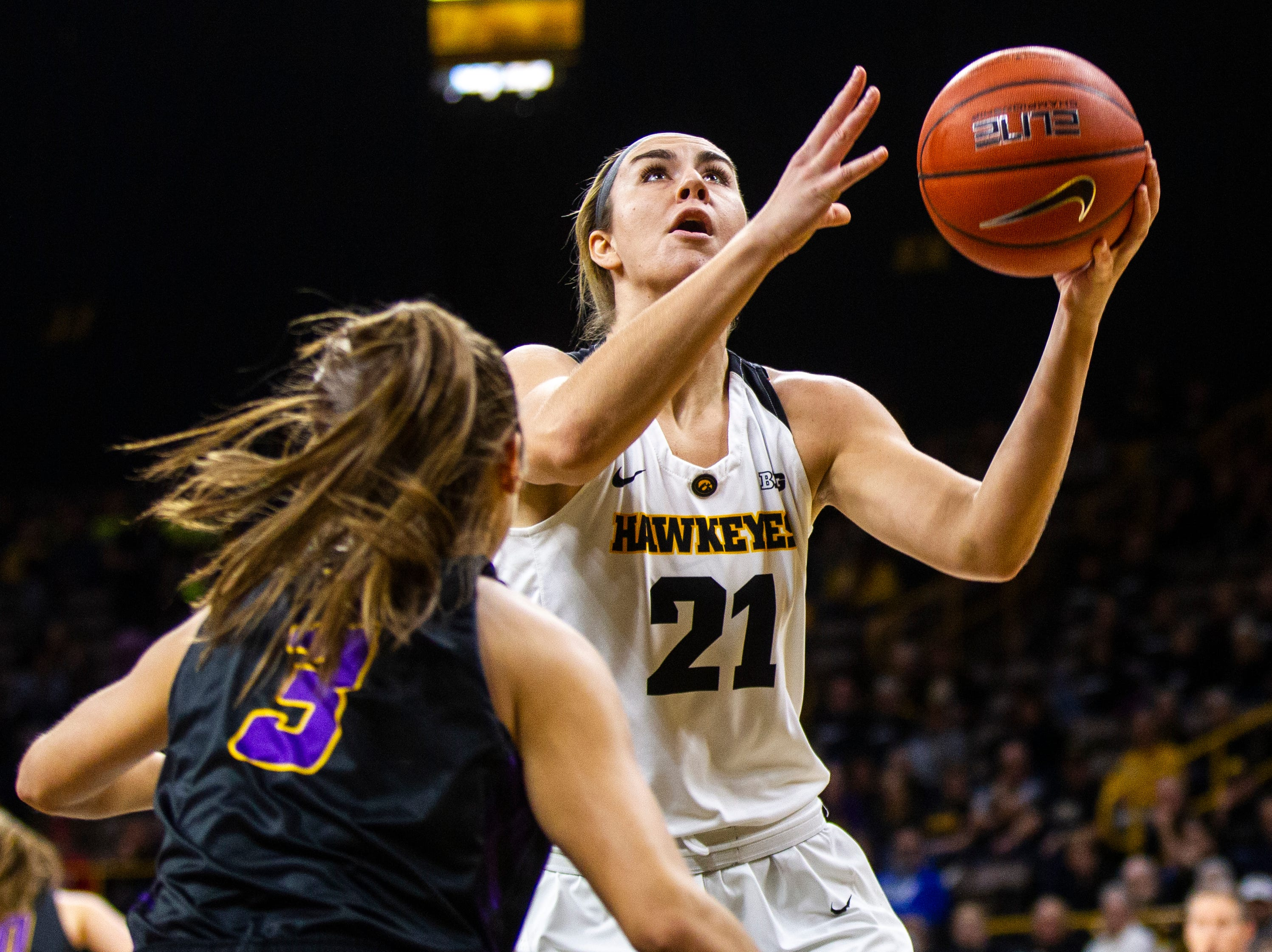 Iowa forward Hannah Stewart (21) attempts a basket during a NCAA women's basketball game on Sunday, Dec. 16, 2018, at Carver-Hawkeye Arena in Iowa City.