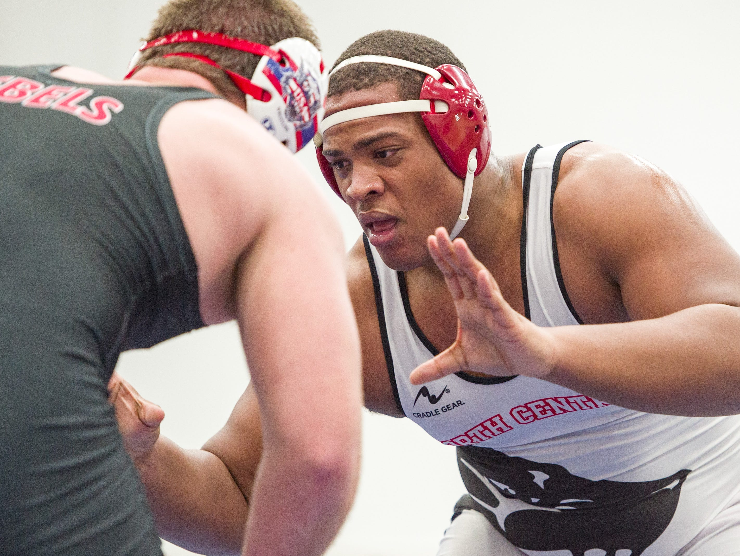 North Central High School wrestler Jamichael Watts, right, wrestles with Roncalli High School's John Harris in the 285-pound weight class. Franklin Central High School hosted the Marion County wrestling championships, Saturday, Dec. 15, 2018.