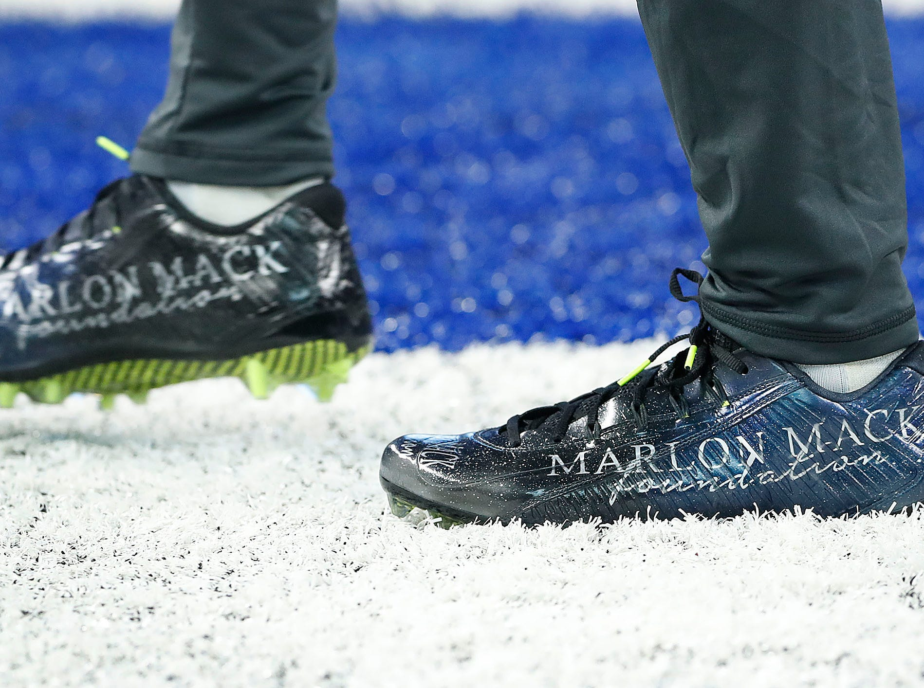 Indianapolis Colts running back Marlon Mack (25) and his My Cleats, My Cause before the start of their game against the Dallas Cowboys at Lucas Oil Stadium on Sunday, Dec. 16, 2018.
