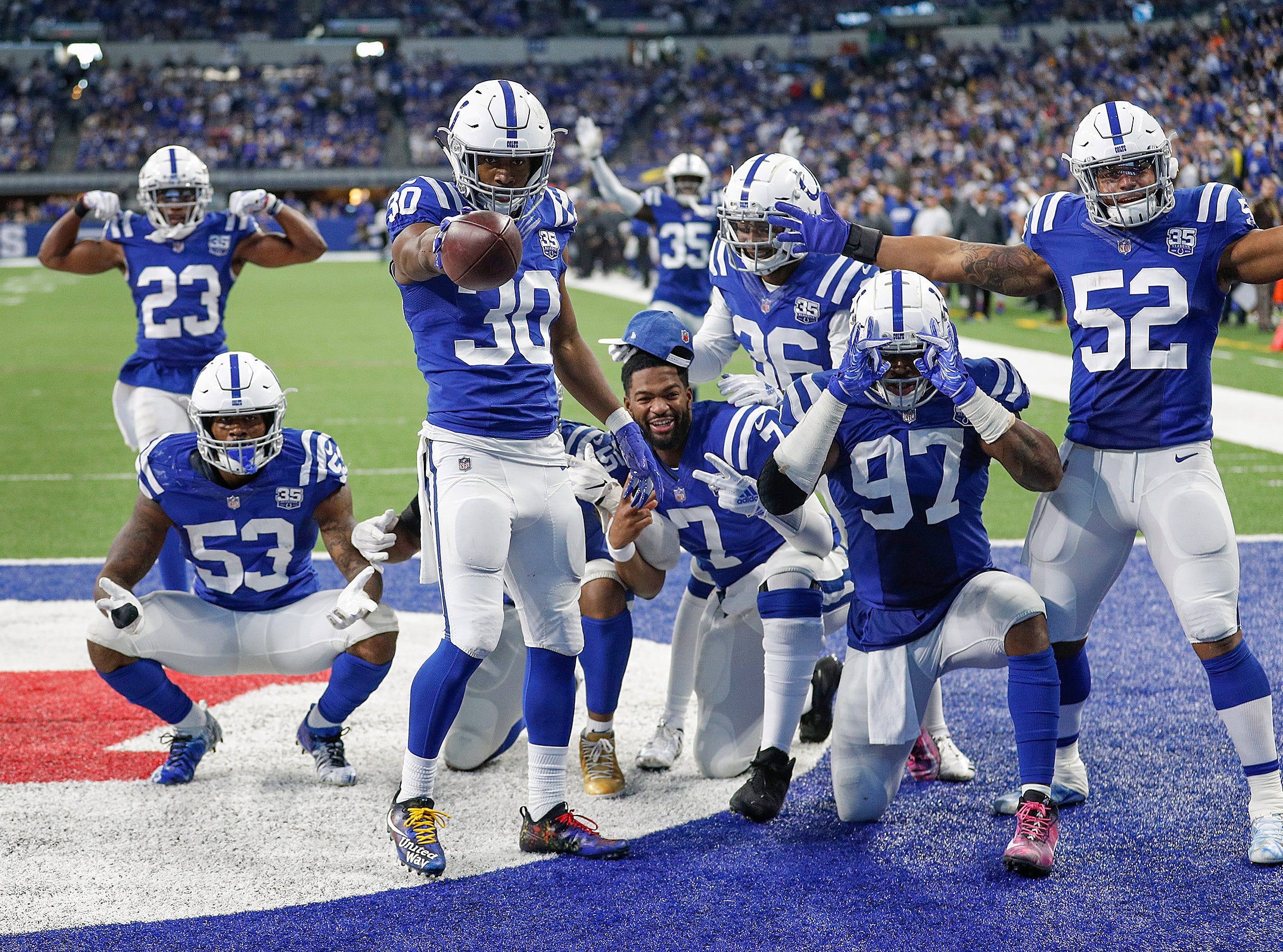 Indianapolis Colts defensive back George Odum (30) celebrates his interception with his teammates late in the fourth quarter of their game at Lucas Oil Stadium on Sunday, Dec. 16, 2018. The Colts shut-out the Cowboys 23-0.
