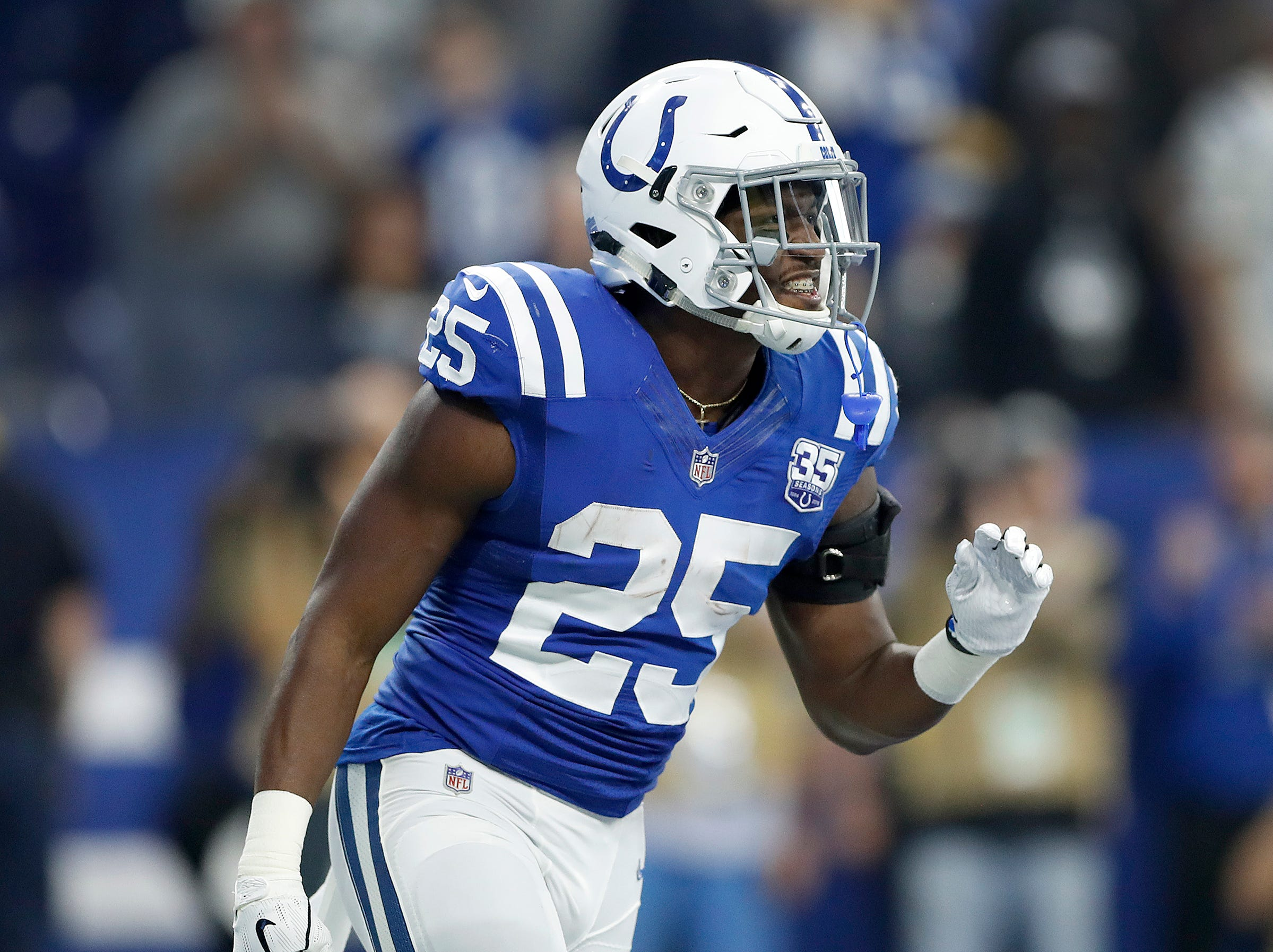 Indianapolis Colts running back Marlon Mack (25) celebrates making it into the end zone in the first half of their game at Lucas Oil Stadium on Sunday, Dec. 16, 2018.