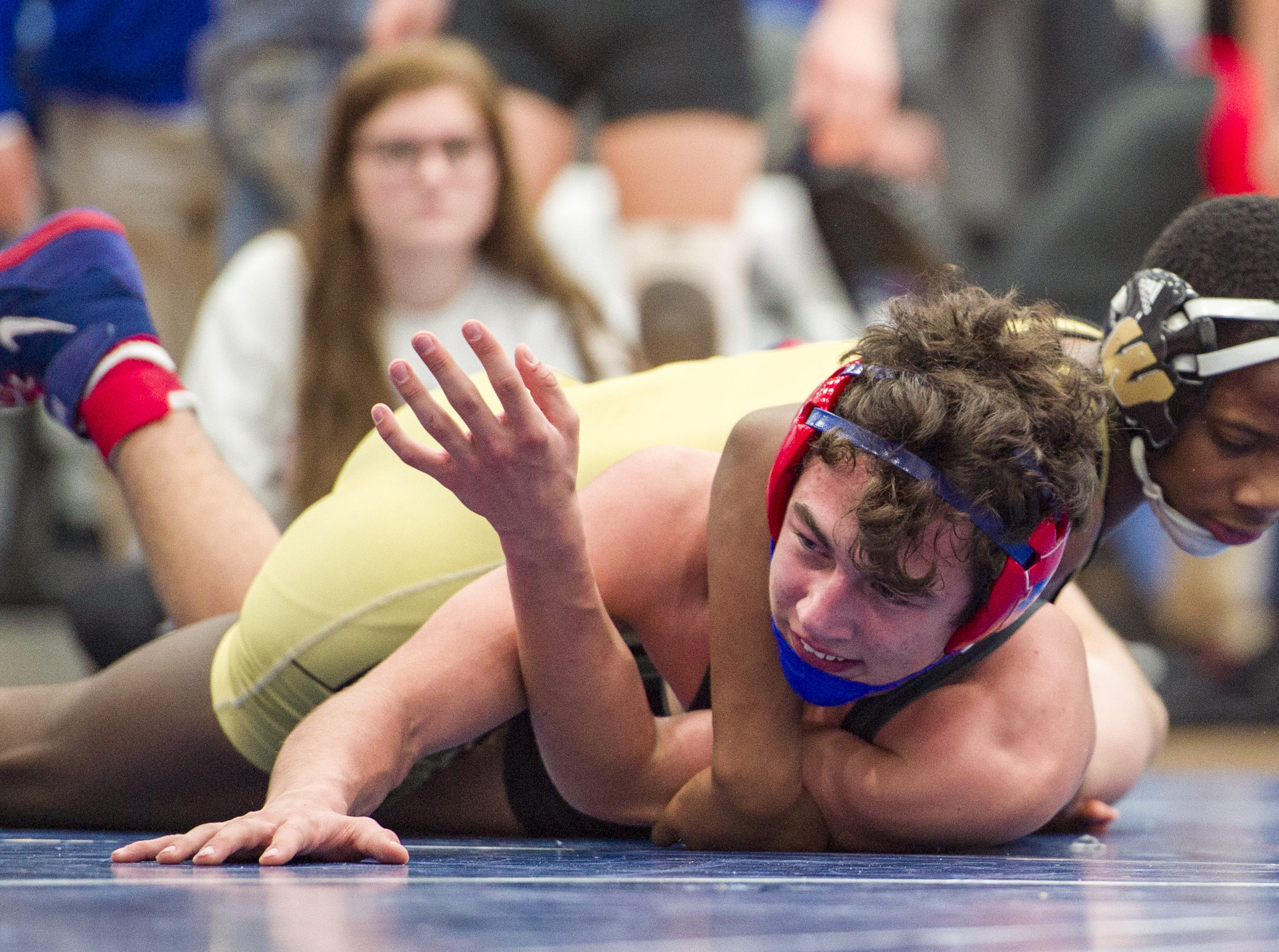 Warren Central High School wrestler Jevian Ross, top, during his match with Roncalli High School's Sam Slivka in the 126-pound weight class. Franklin Central High School hosted the Marion County wrestling championships, Saturday, Dec. 15, 2018.