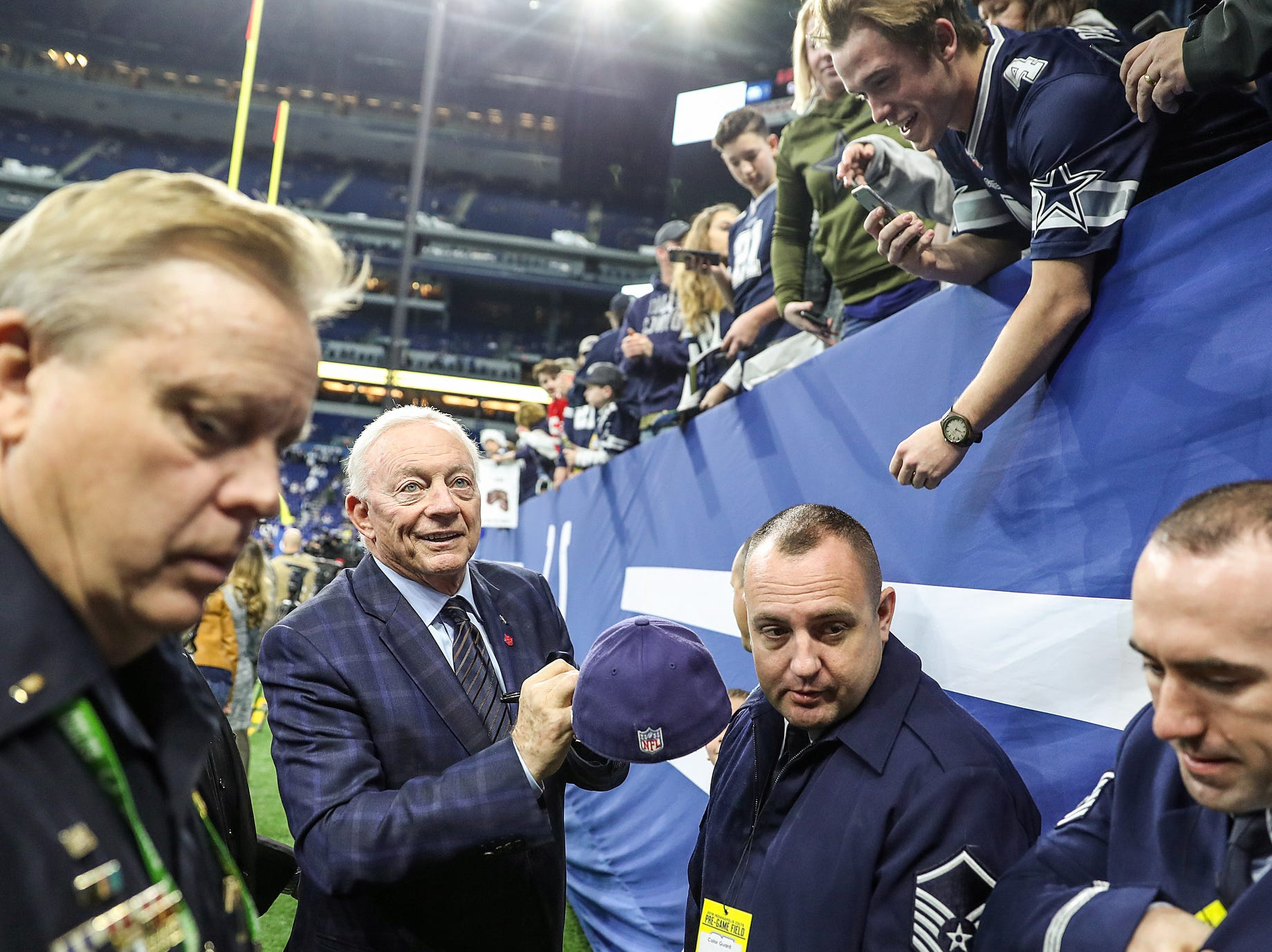 Dallas Cowboys owner Jerry Jones signs autographs for fans before the team faced the Indianapolis Colts in week 15 at Lucas Oil Stadium in Indianapolis, Sunday, Dec. 16, 2018.