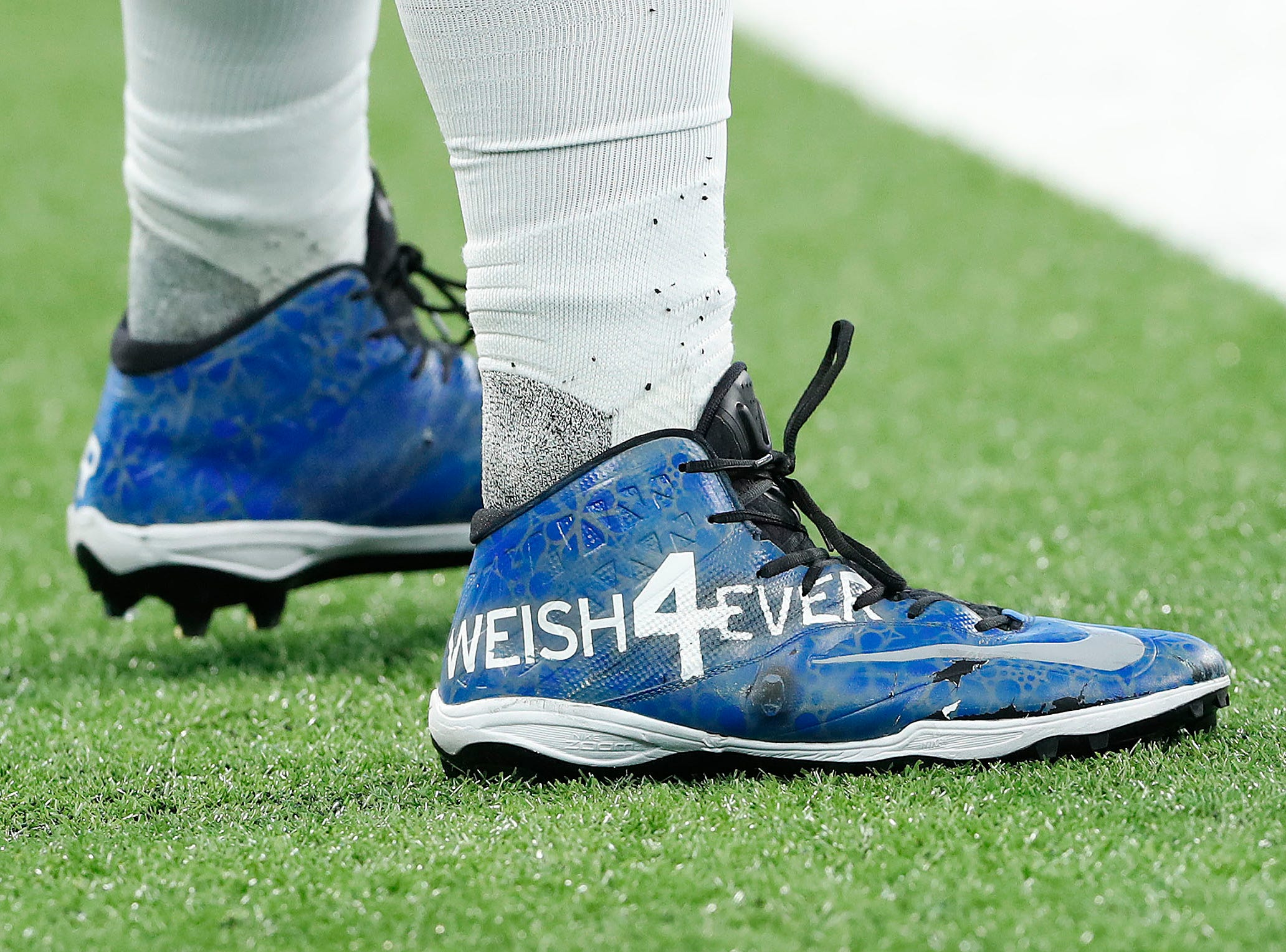 Indianapolis Colts offensive guard Quenton Nelson (56) and his My Cleats, My Cause before the start of their game against the Dallas Cowboys at Lucas Oil Stadium on Sunday, Dec. 16, 2018.
