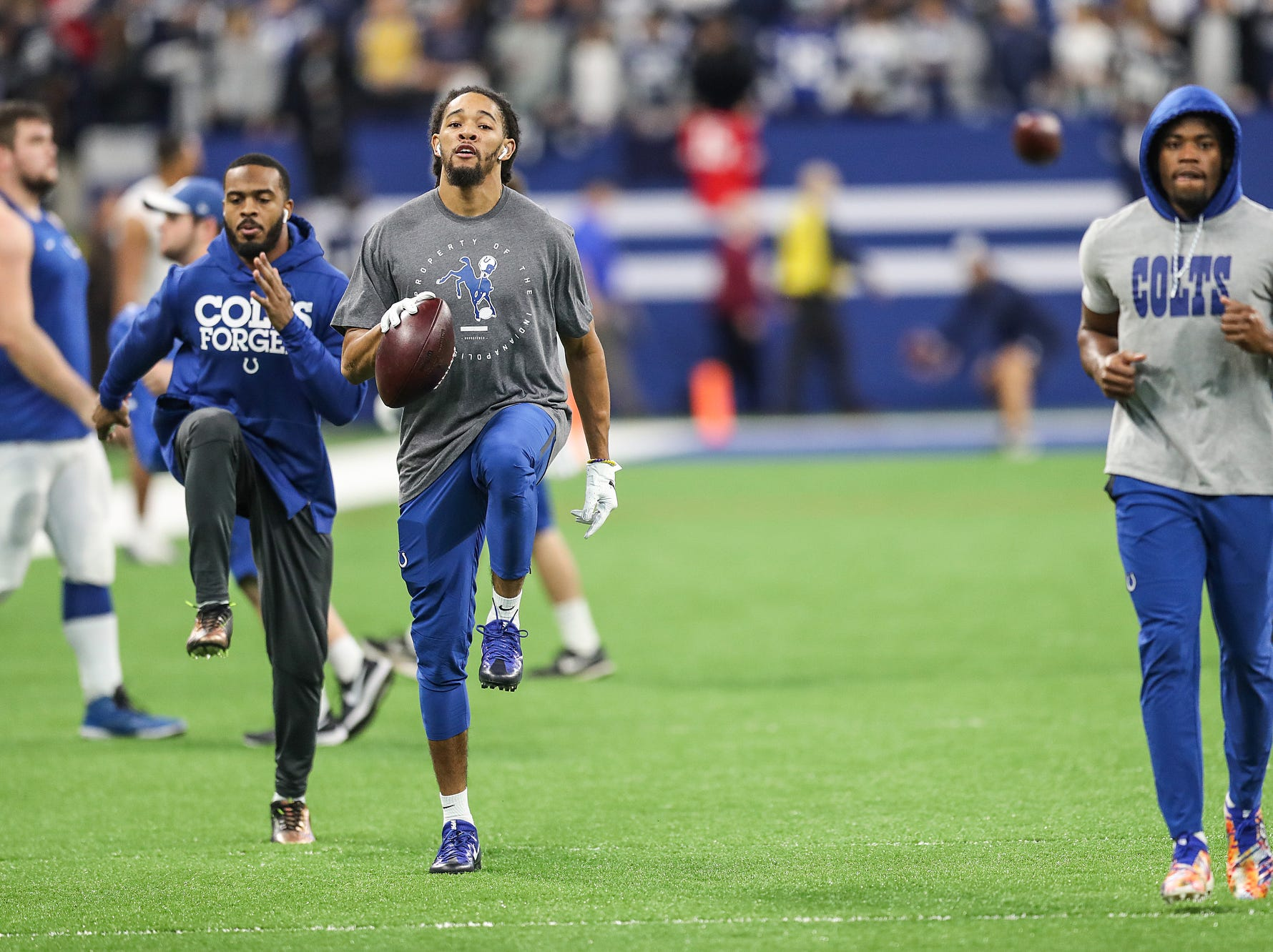 Some of the Indianapolis Colts warm up before they faced the Dallas Cowboys in week 15 at Lucas Oil Stadium in Indianapolis, Sunday, Dec. 16, 2018.