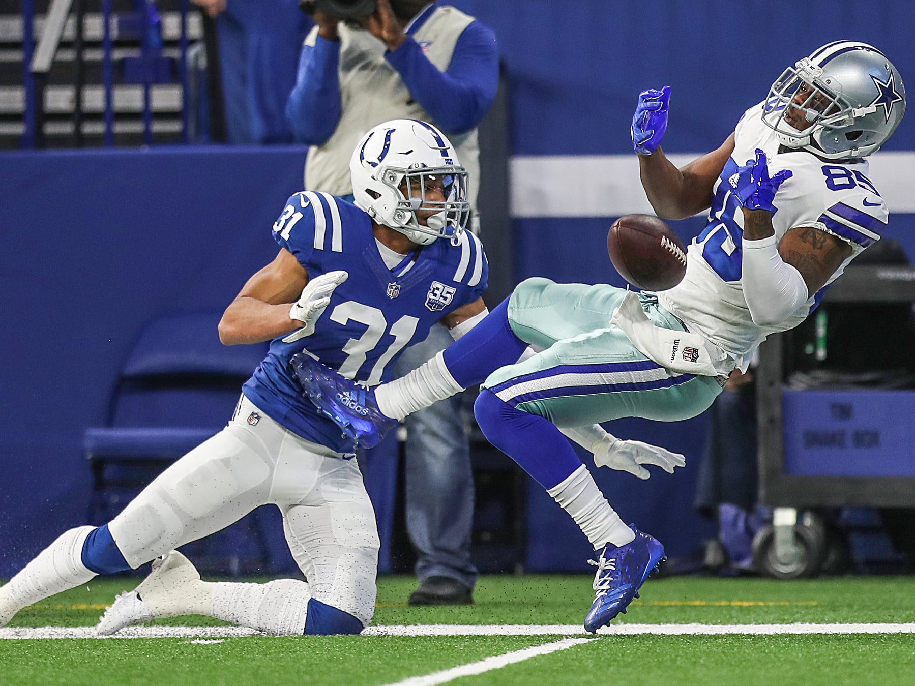 Indianapolis Colts cornerback Quincy Wilson (31) keeps Dallas Cowboys wide receiver Noah Brown (85) from receiving a long pass in the first half of the game at Lucas Oil Stadium in Indianapolis, Sunday, Dec. 16, 2018.