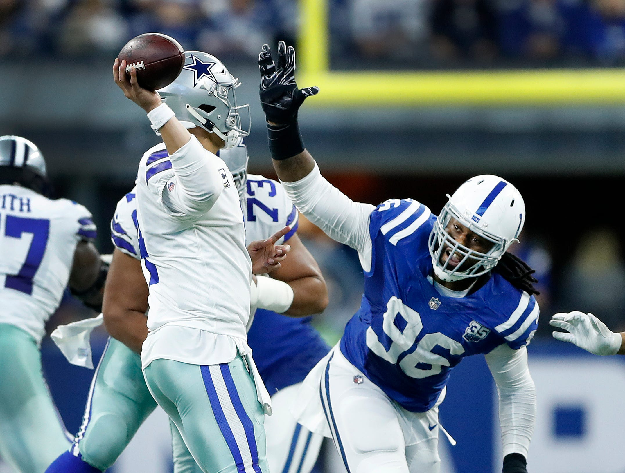 Indianapolis Colts defensive tackle Denico Autry (96) pressures Dallas Cowboys quarterback Dak Prescott (4) in the second half of their game at Lucas Oil Stadium on Sunday, Dec. 16, 2018. The Colts shut-out the Cowboys 23-0.