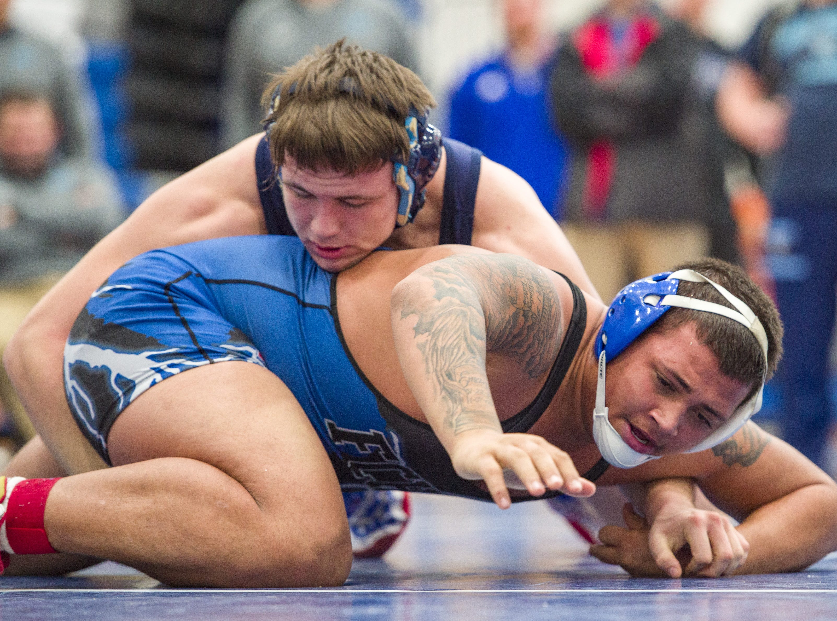 Perry Meridian High School wrestler Austin Lane, top, competes with Franklin Central High School's Deshawn Young in the 220-pound weight class. Franklin Central High School hosted the Marion County wrestling championships, Saturday, Dec. 15, 2018.