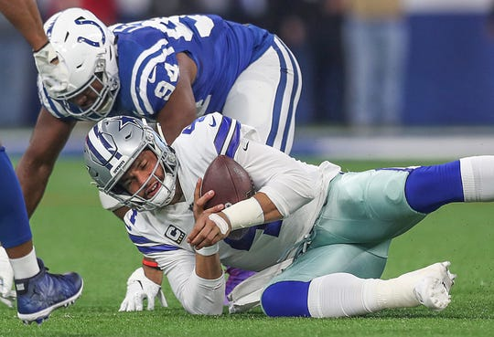 Indianapolis Colts defensive end Tyquan Lewis (94) gets up after sacking Dallas Cowboys quarterback Dak Prescott (4) in the first half of the game at Lucas Oil Stadium in Indianapolis, Sunday, Dec. 16, 2018.